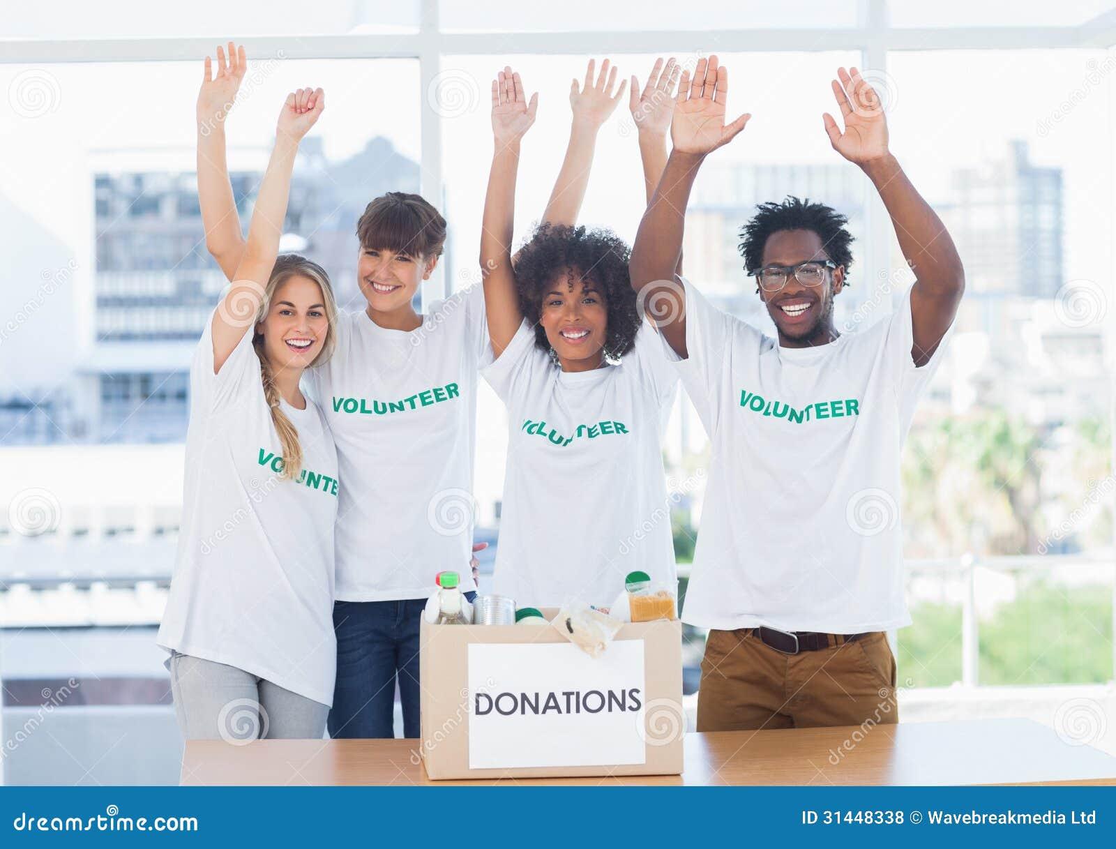 Volunteers raising their arms