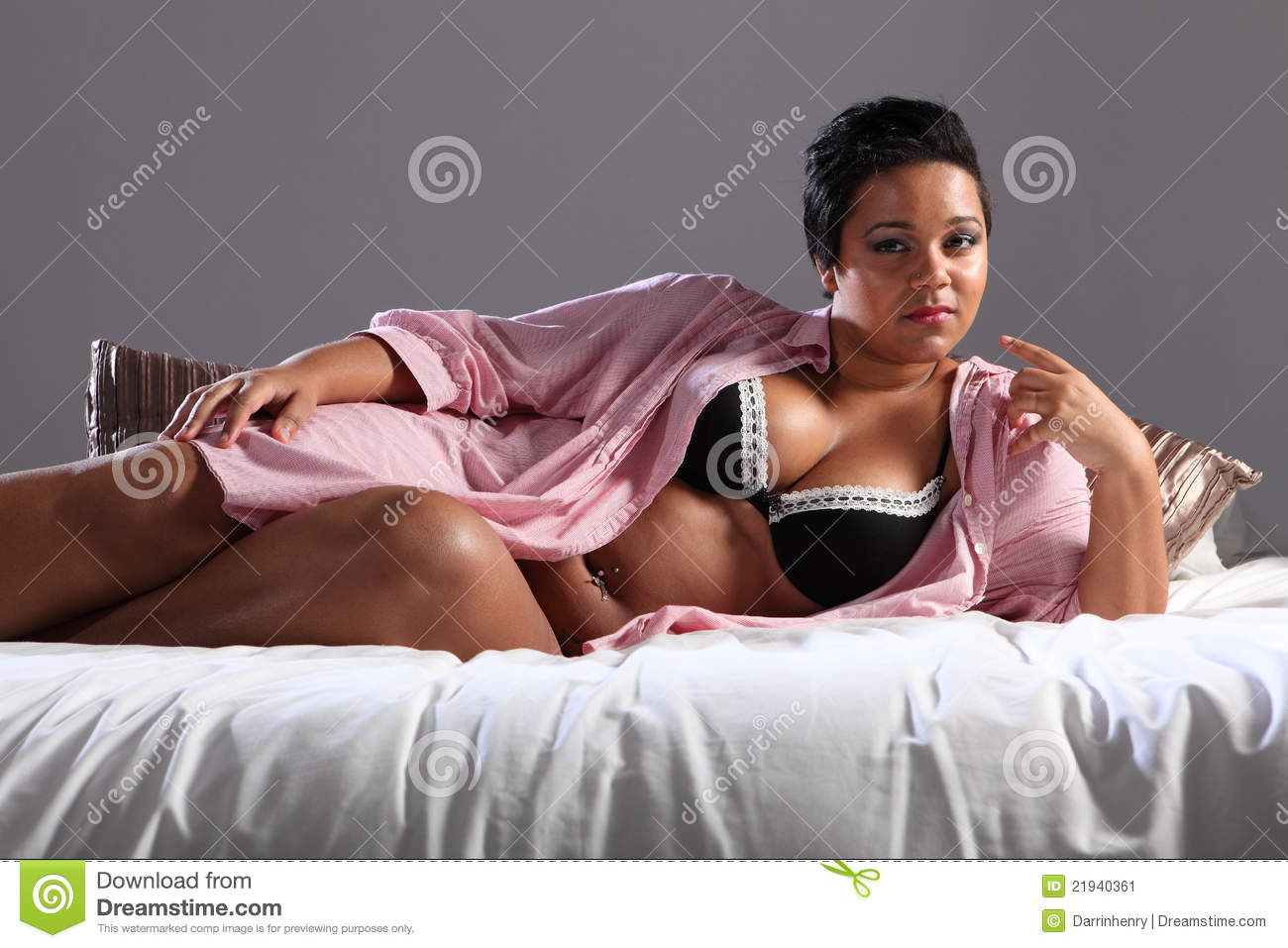 voluptuous plus size african woman lying in bed stock image - image