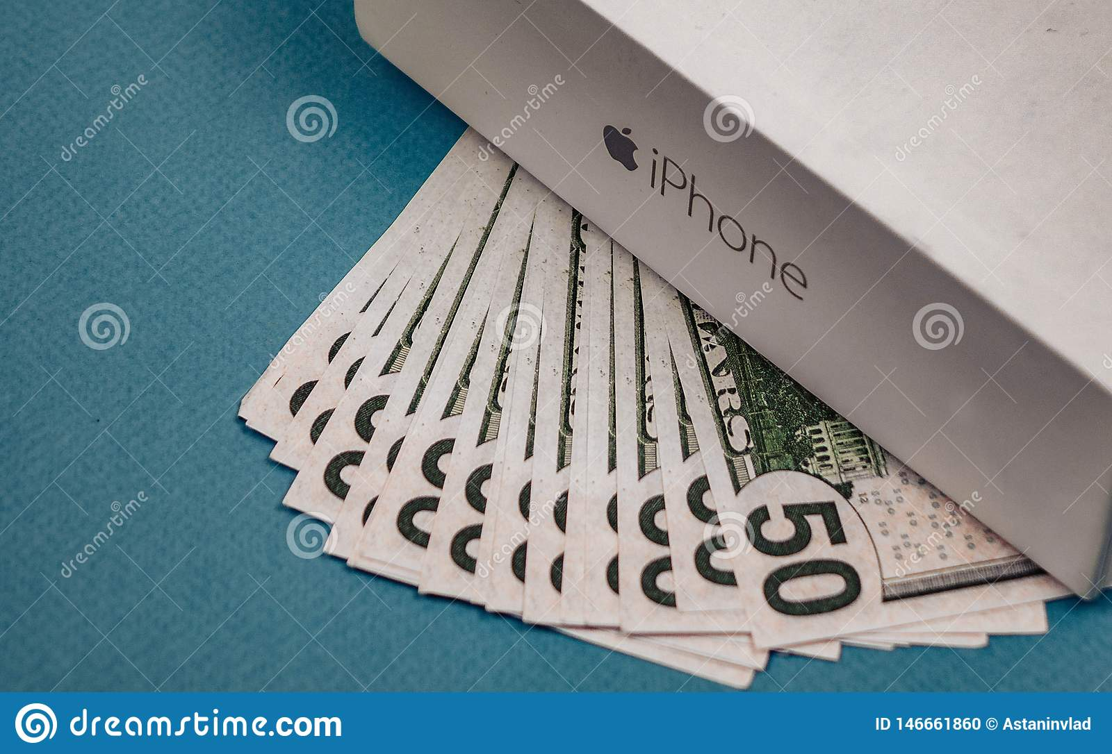 Voronezh Russia - may 3, 2019. Apple Inc. logo and fifty dollar bills on the blue background