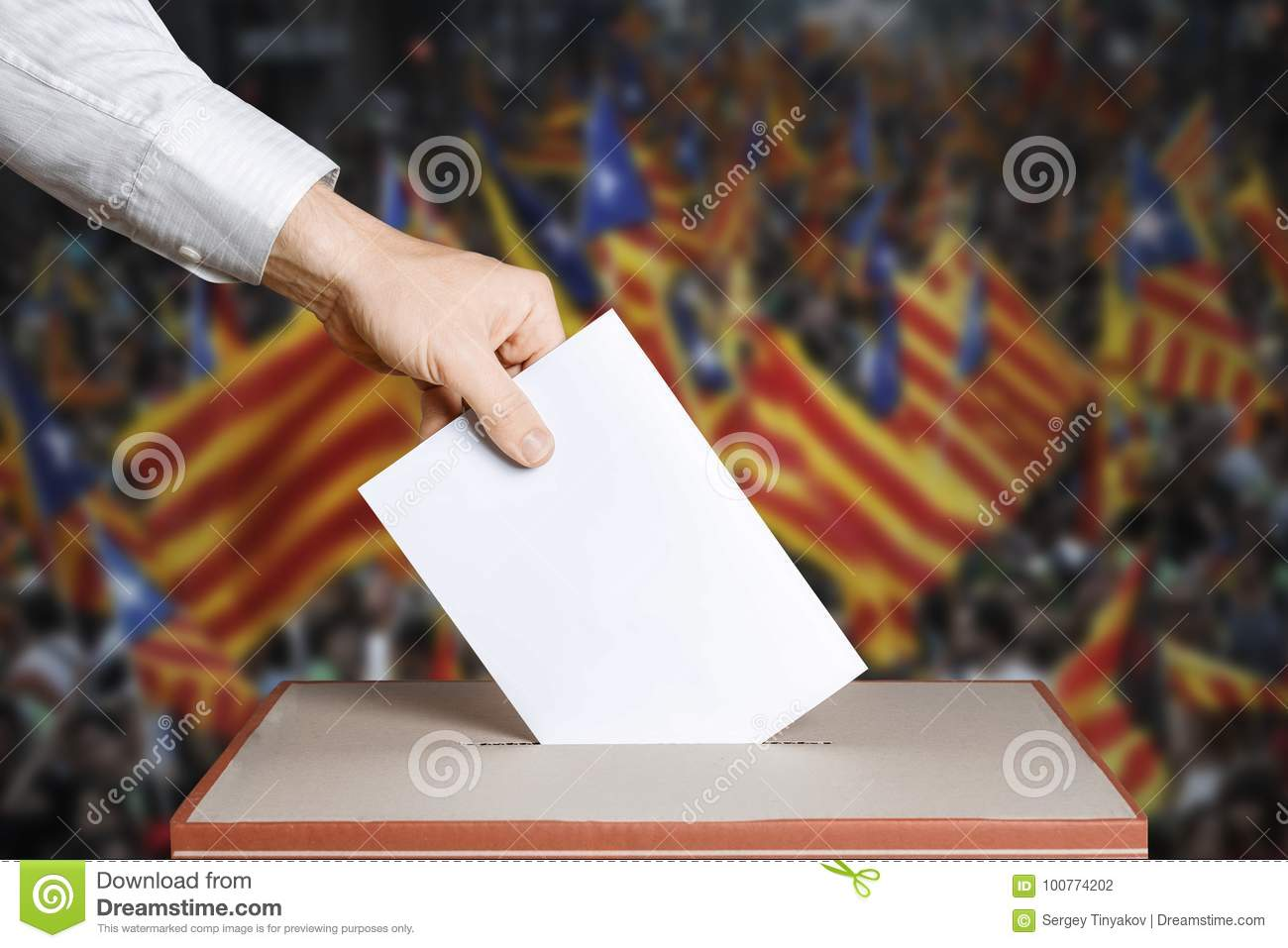 Voter Holds Envelope In Hand Above Vote Ballot. Catalonia Flags background. Democracy Concept