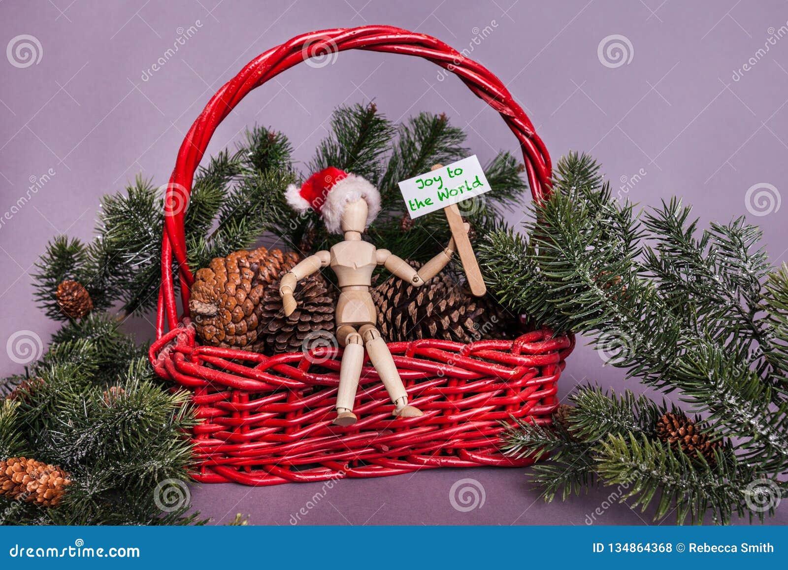 Vreugde aan het teken van het wereldpiket door Houten verbonden pop wordt gehouden die een Santa Claus-scène die van hoedenkerstm