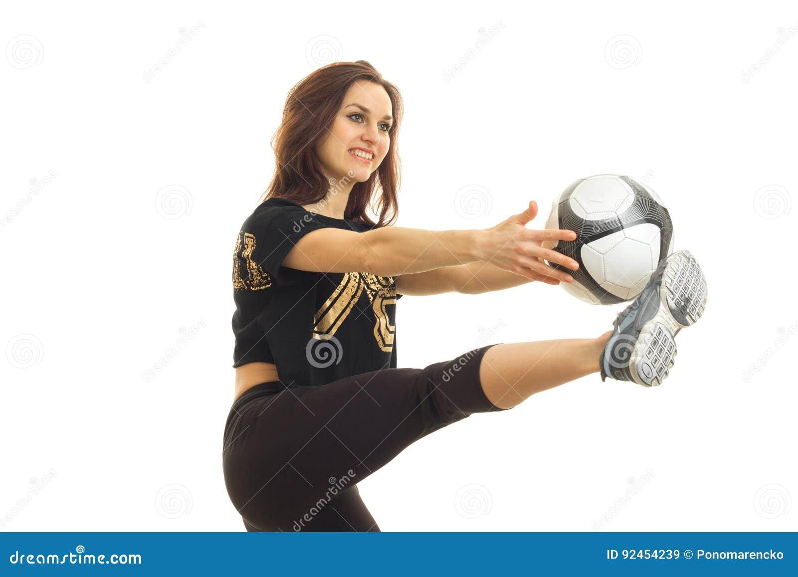 Vrolijk jong meisjes speelvoetbal met bal