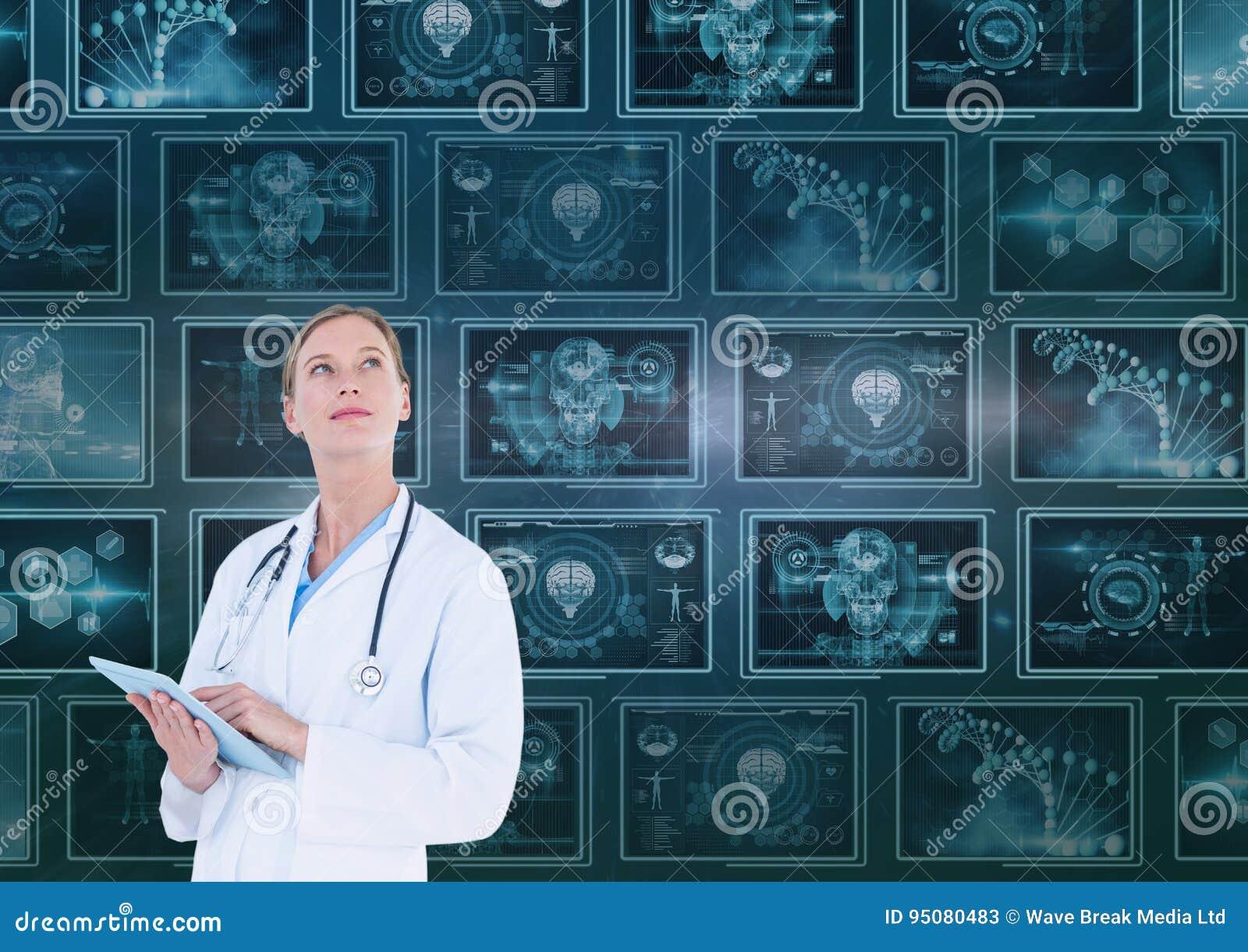 Vrouw arts die omhoog tegen achtergrond met medische interfaces kijken