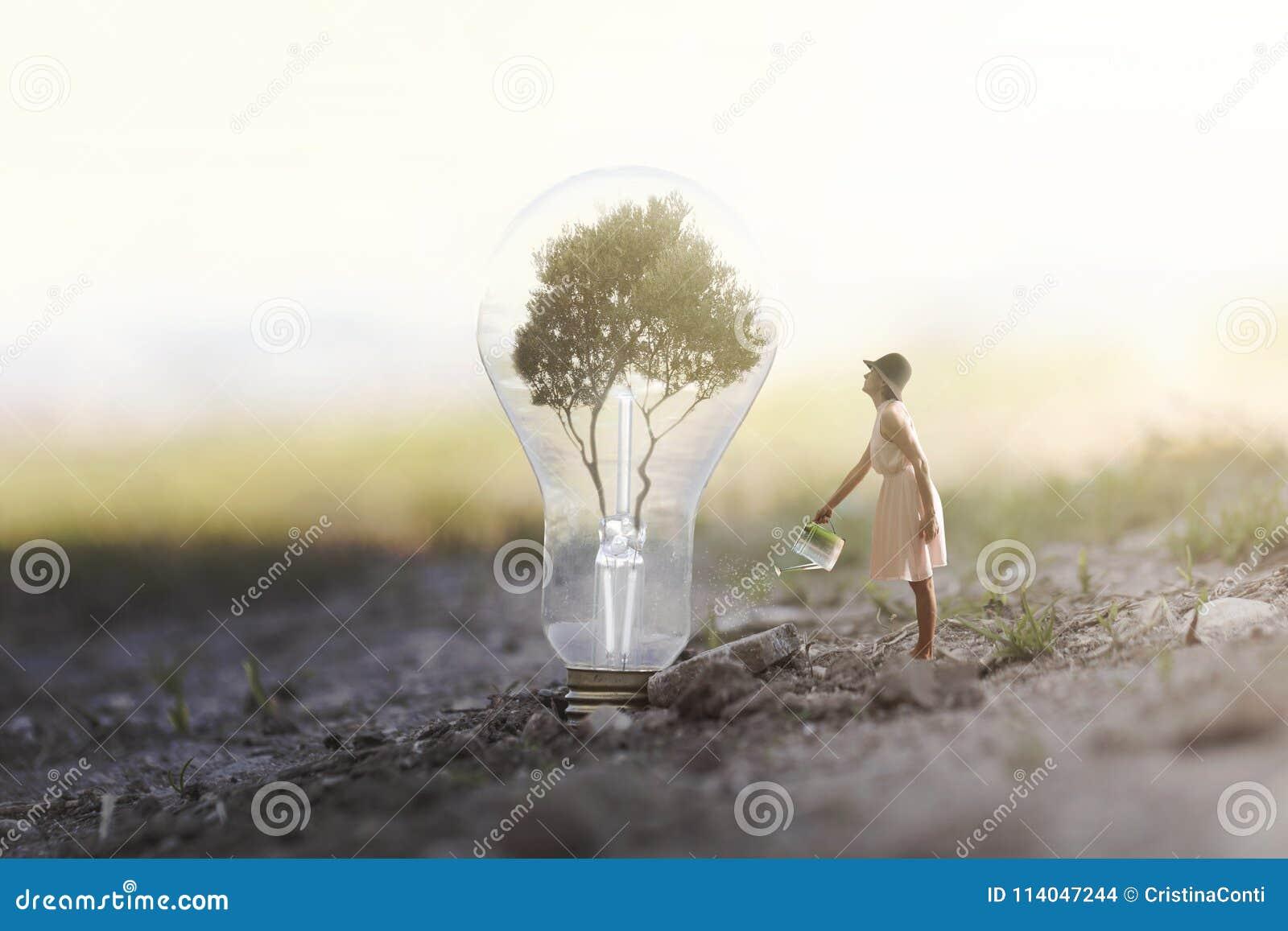 Vrouw die haar installatie water geven die energie aan een gloeilamp vergt