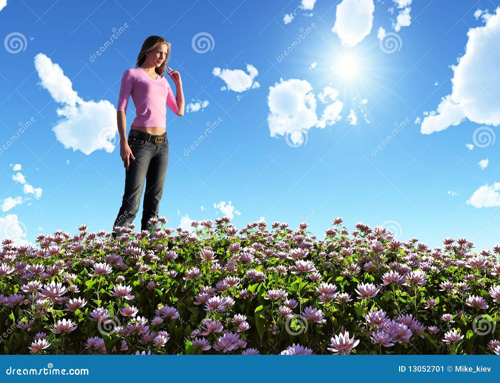 Vrouw op bloeiend gebied