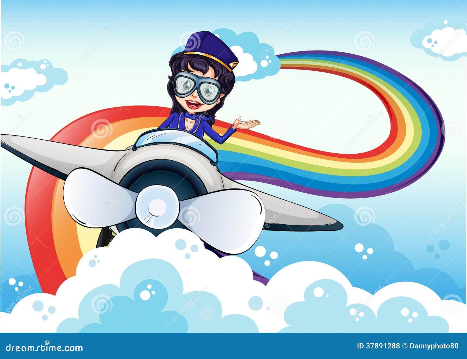 Vrouwelijke proef drijvend het vliegtuig en een regenboog in de hemel