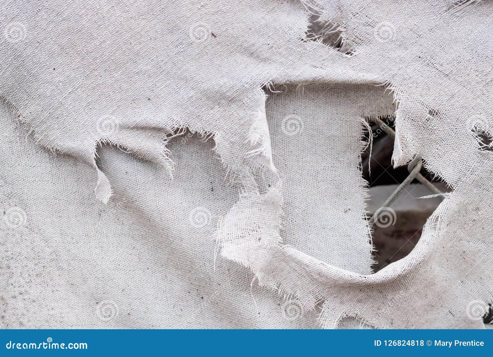 Vuile witte grijze gescheurde grunge uitstekende van het stoffencanvas textuur als achtergrond die, met kettingsverbinding door e