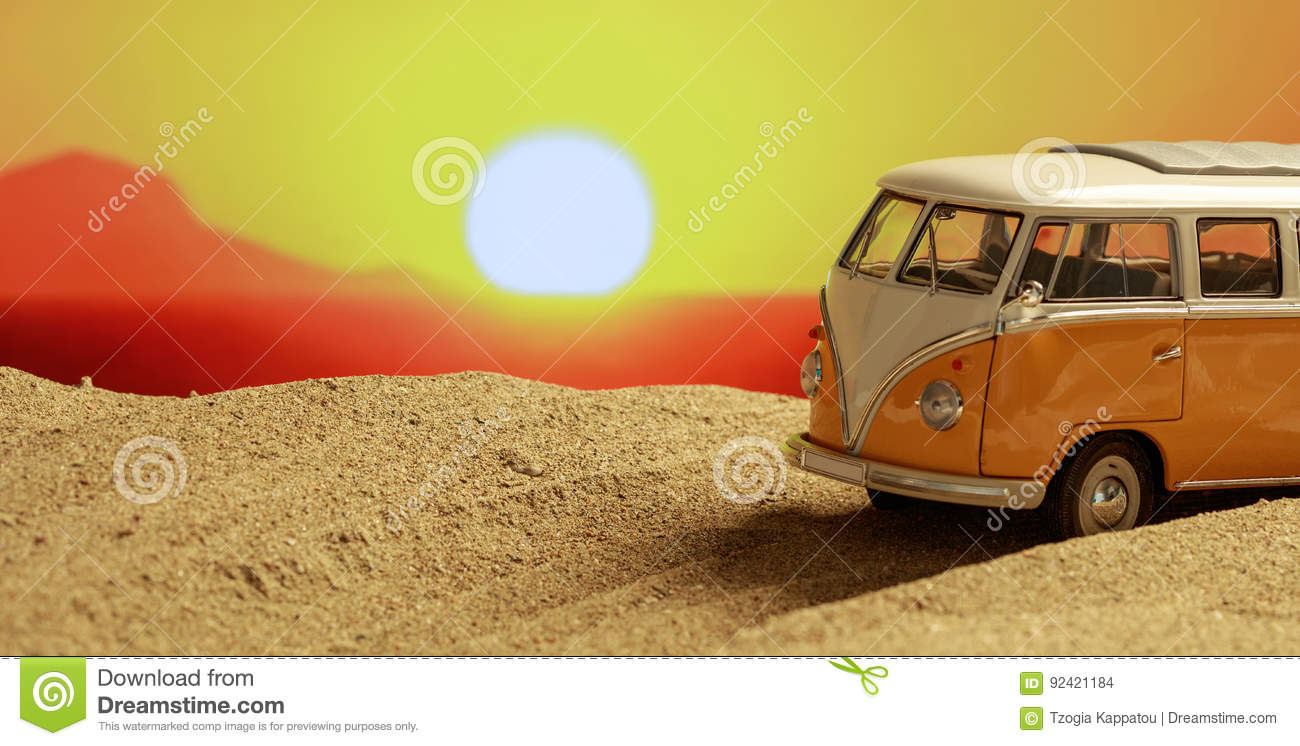 VW van on the beach at sunset