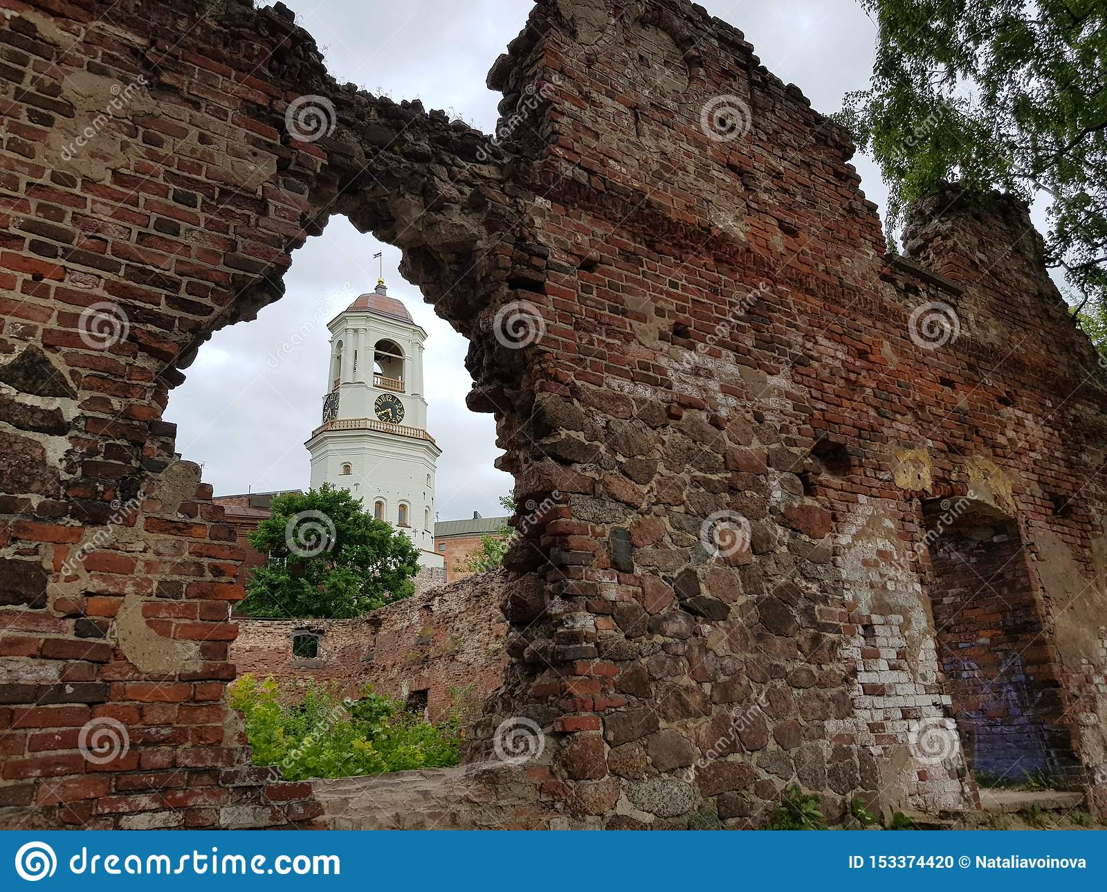 Vyborg. View of the Clock Tower through the window of the destroyed house.