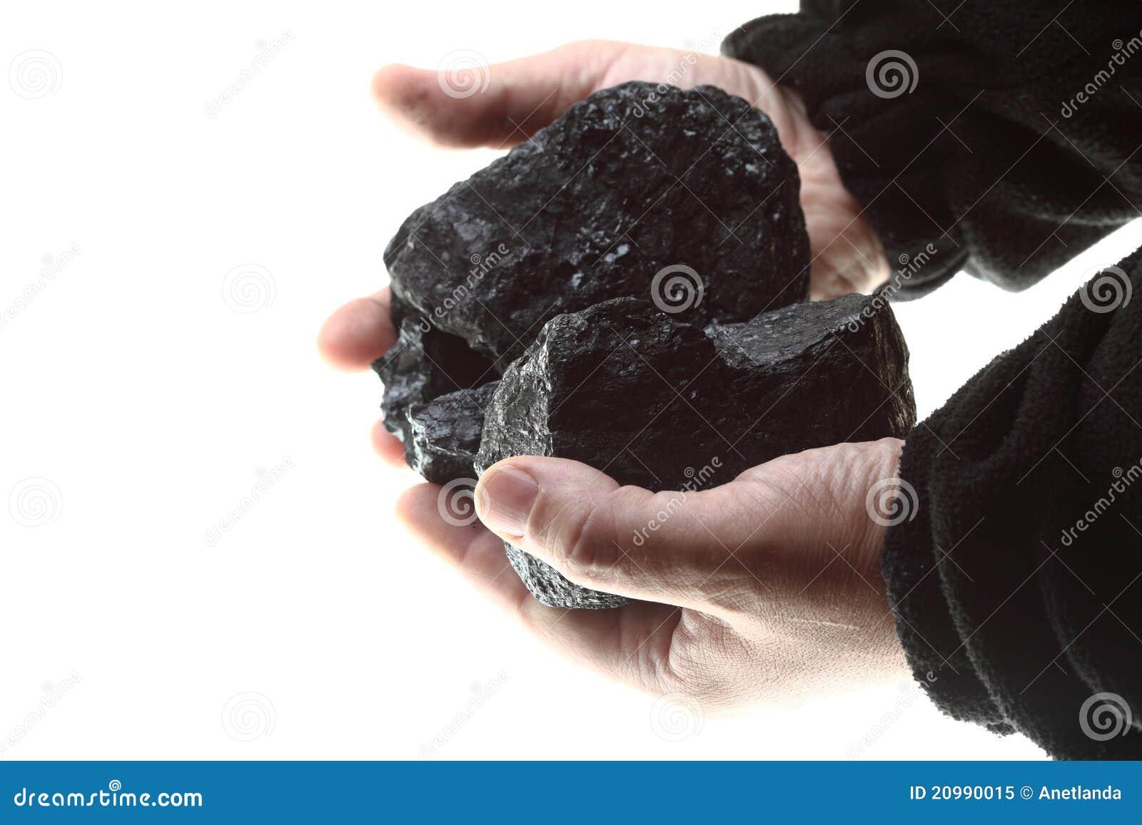 Węglowej ręki odosobneni kawałki biały