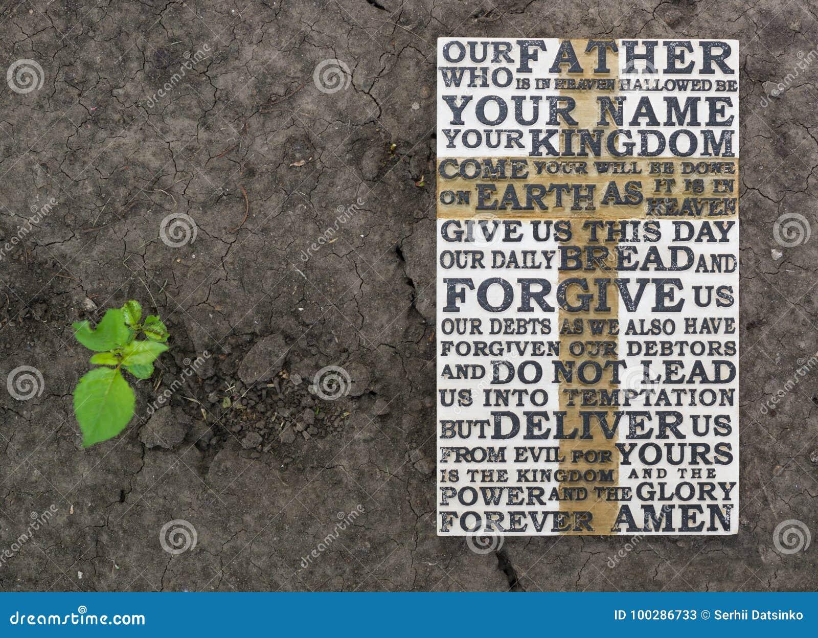 Władyki ` s modlitwa Drewniany rzeźbiący słowo władyki ` s modlitwa na zmielonym tle z zieloną rośliną