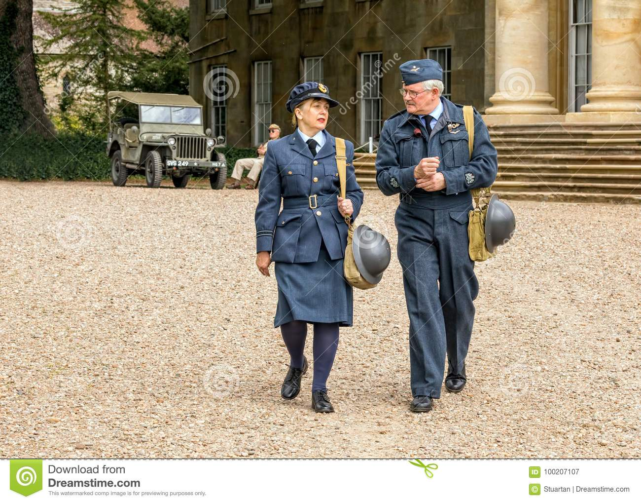 c0393777de5 Re-enactors dressed in WW2 uniforms of a Flight Officer in the Women`s  Auxiliary Air Force and the male as a Royal Air Force Observer with the  rank of ...