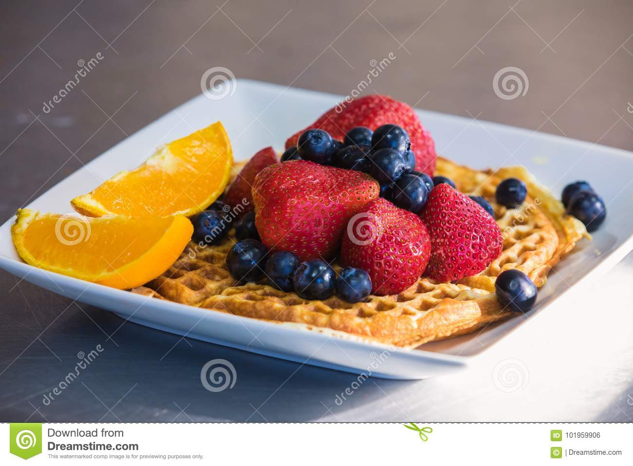 Waffle with berries and orange