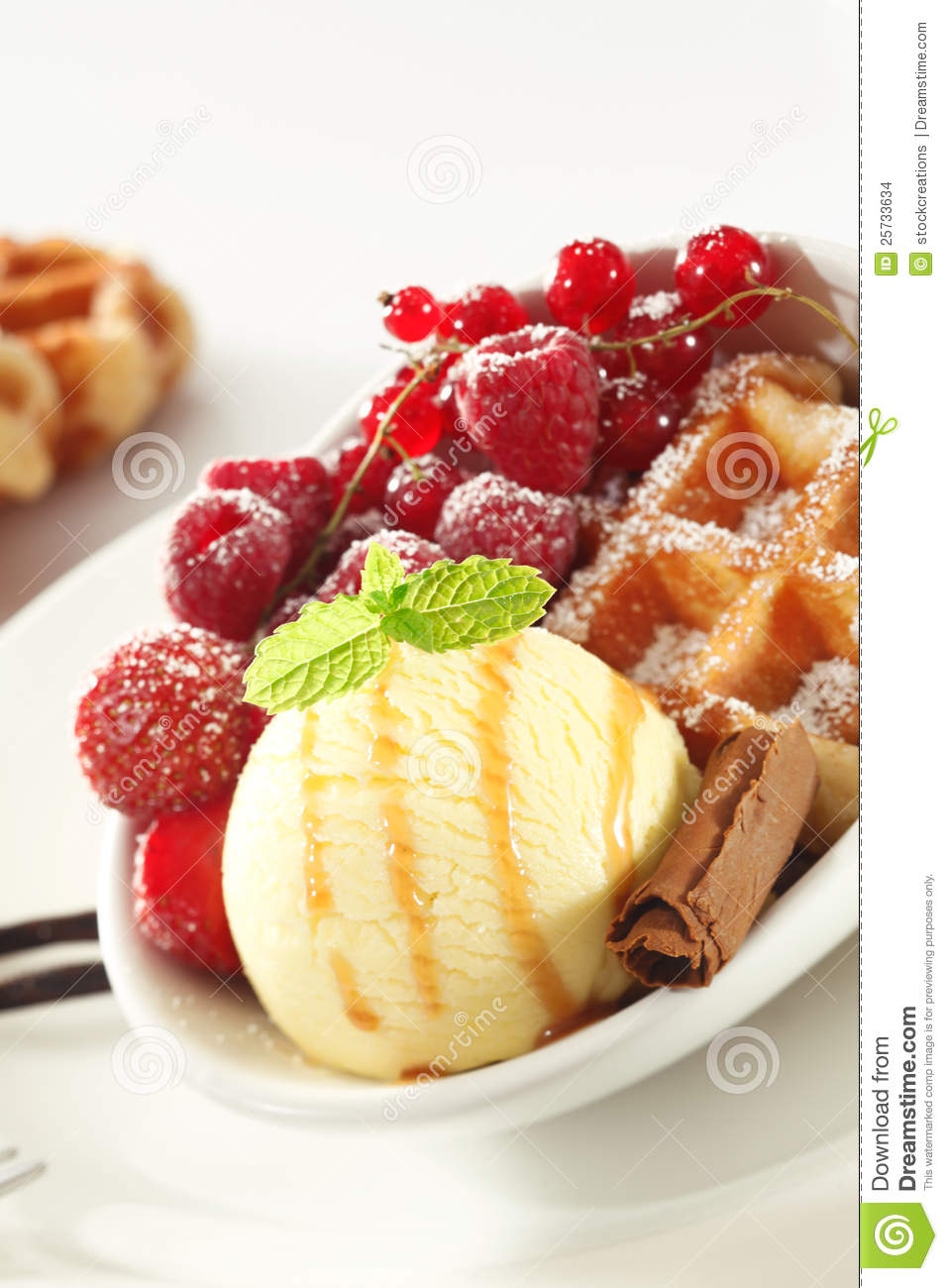 Waffle with fresh berries and ice-cream