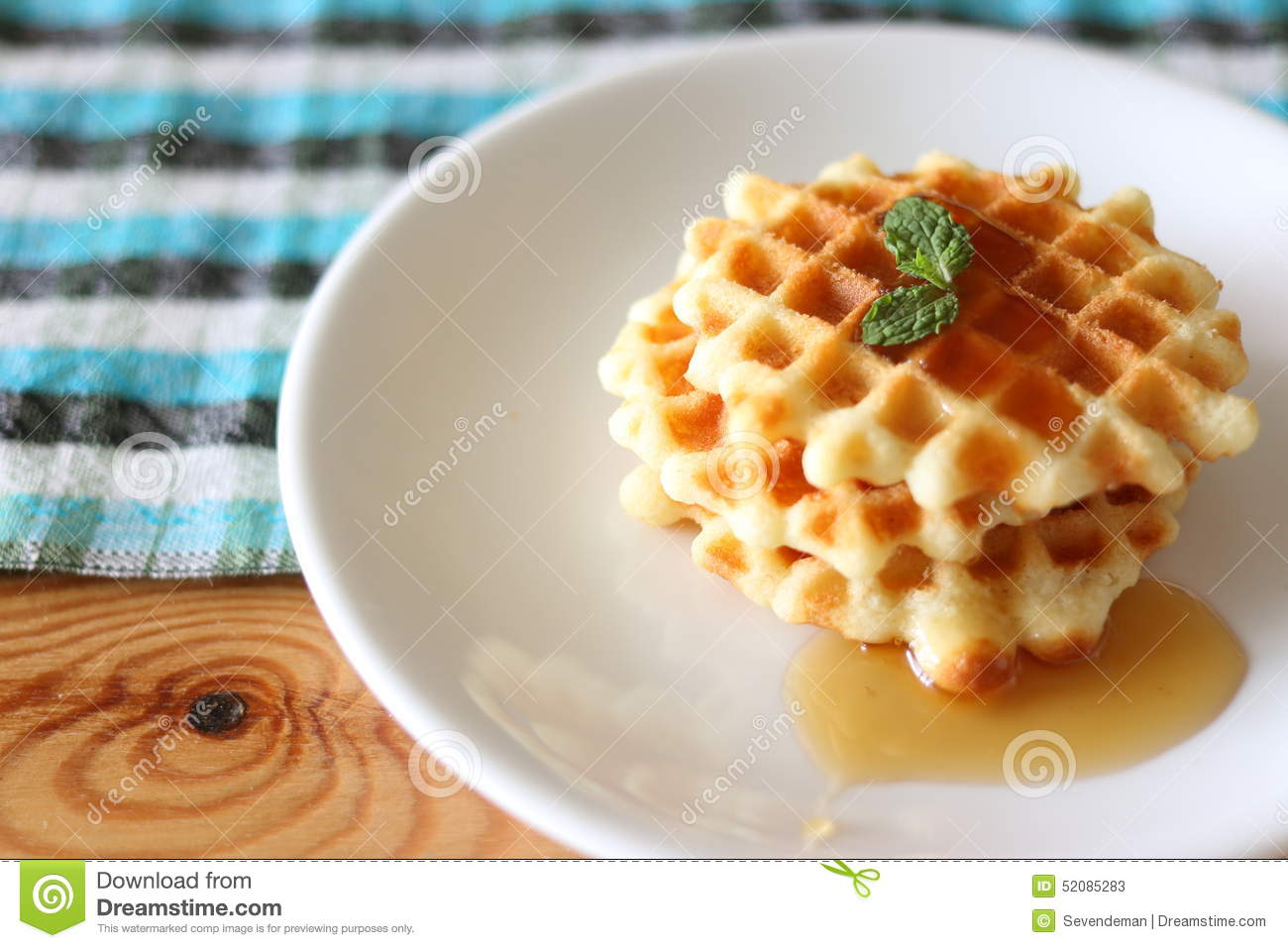 Waffles and a cup of coffee.