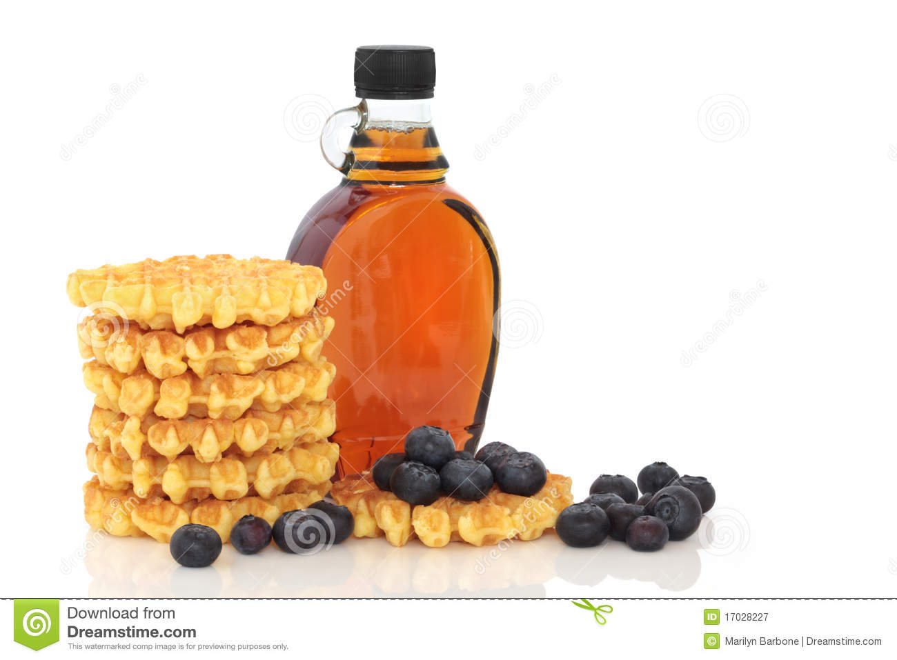 Blueberry fruit with waffles and maple syrup, isolated over white ...
