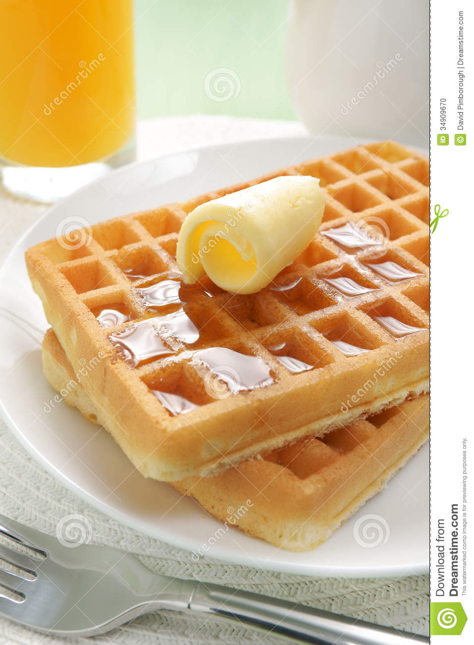 Waffles and maple syrup stock photo. Image of pitcher ...