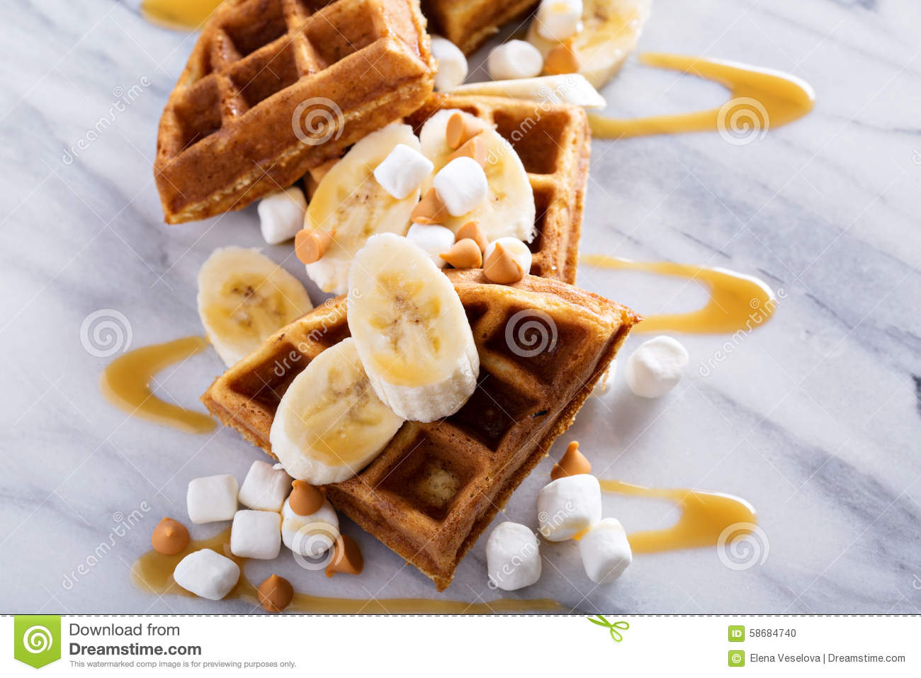 Waffles with peanut butter and bananas