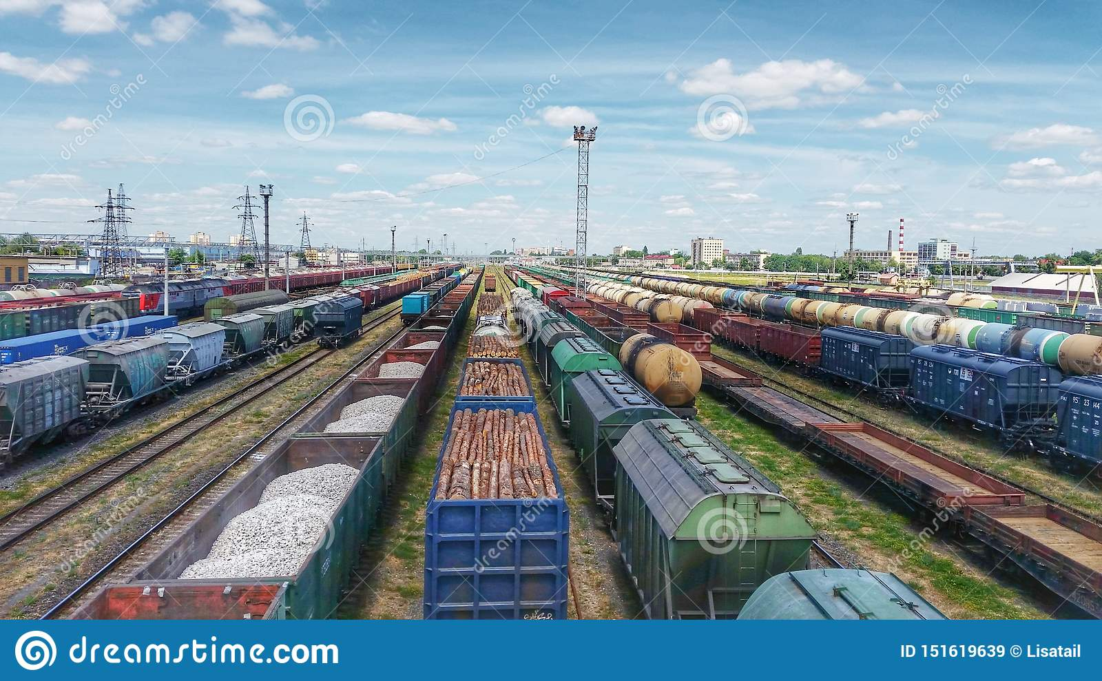 Top view of cargo trains. Aerial view from flying drone of colorful freight trains on the railway station