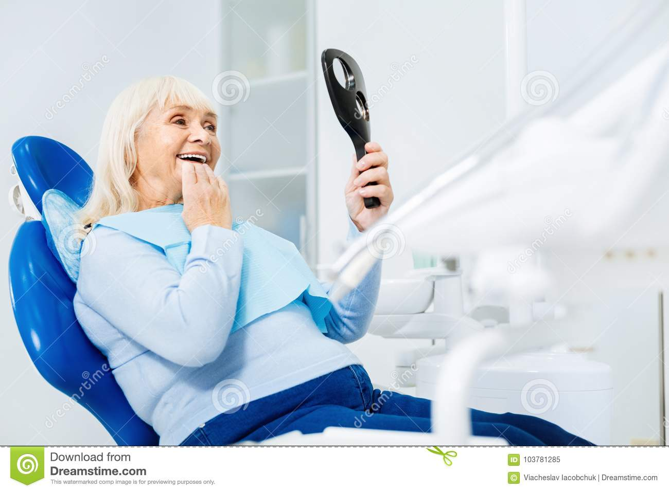Waist up of delighted woman in dental office