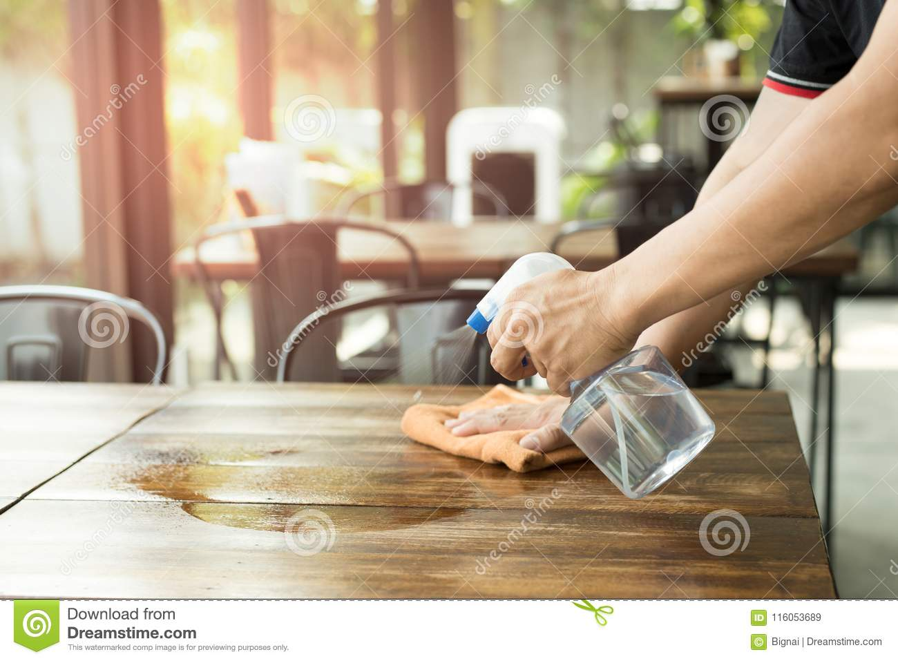Waiter Cleaning The Table With Disinfectant Spray Stock Image - Restaurant table cleaner