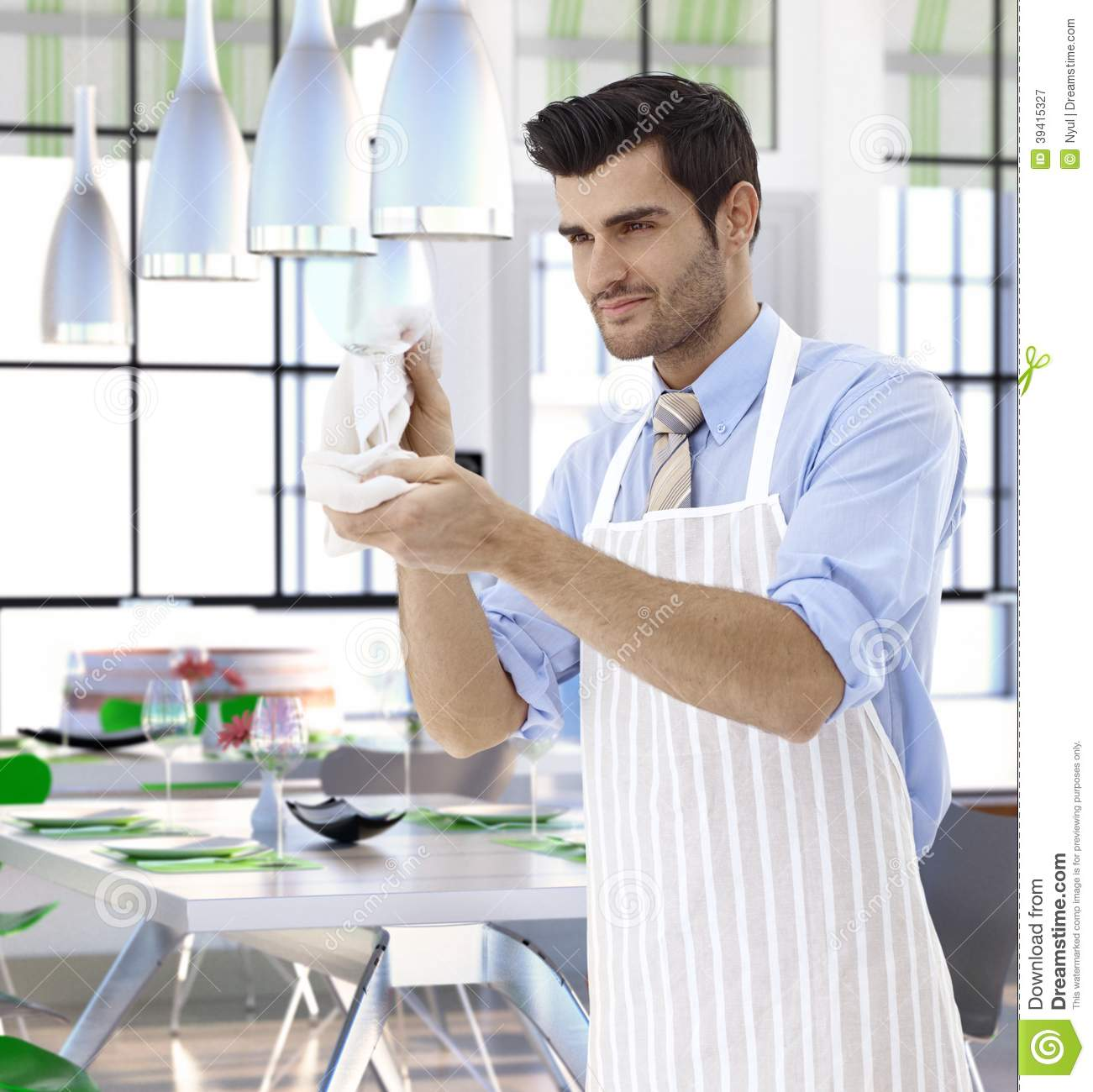 People Cleaning Services : Waiter cleaning wineglass at restaurant stock photo