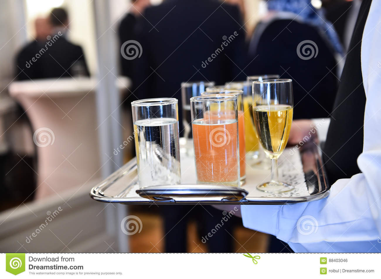 Waiter holding a tray with beverages during cocktail party