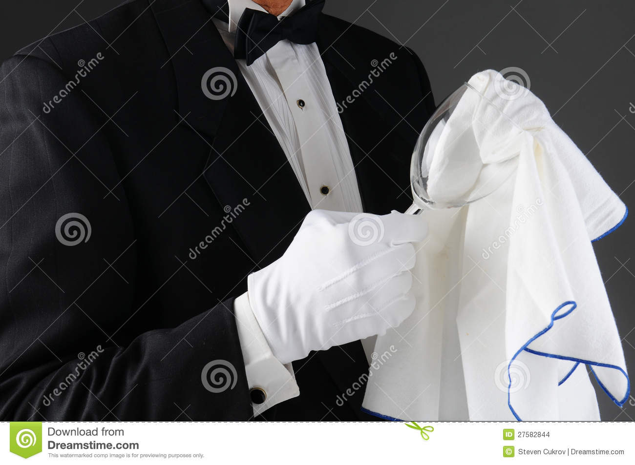 Waiter Polishing Wineglass
