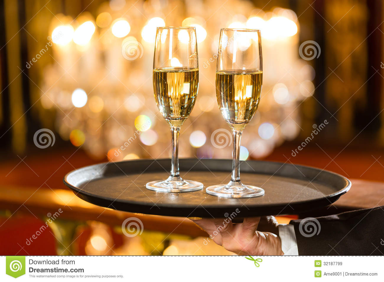 Waiter Served Champagne Glasses On Tray In Restaurant Royalty Free Stock Imag