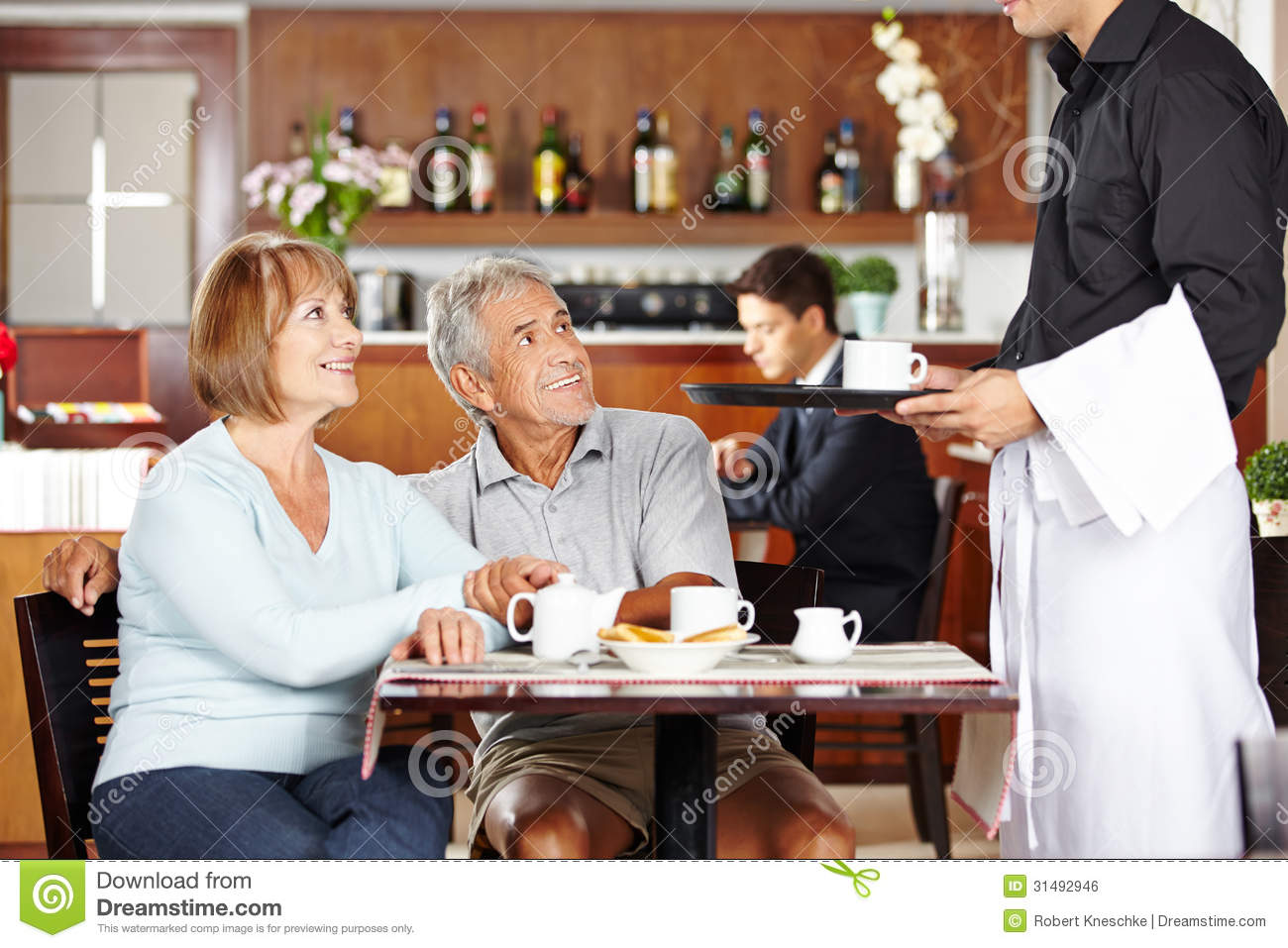 Kitchen themes coffee - Waiter Serving Seniors In Coffee Shop Royalty Free Stock Image Image