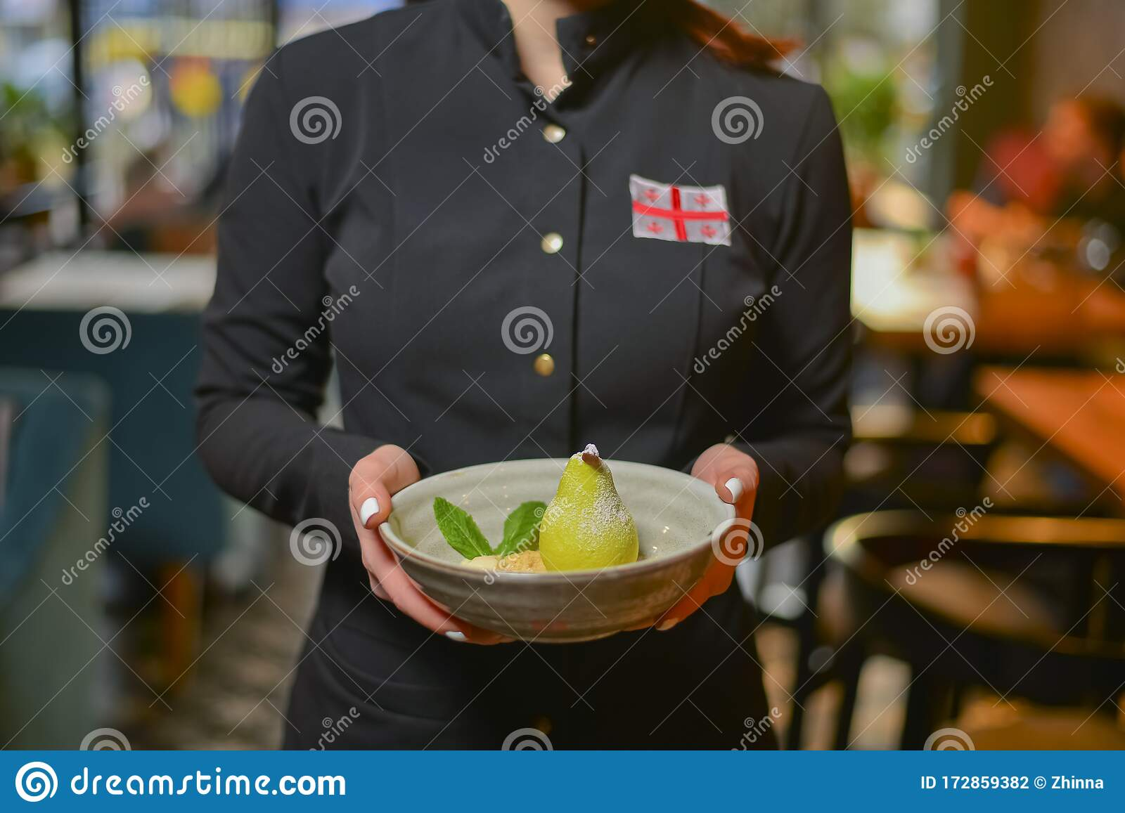 Waiter Serving Sweet Unique Dessert White Chocolate Pear Served In A Bowl In Restaurant Stock Photo Image Of Dishes Dessert 172859382