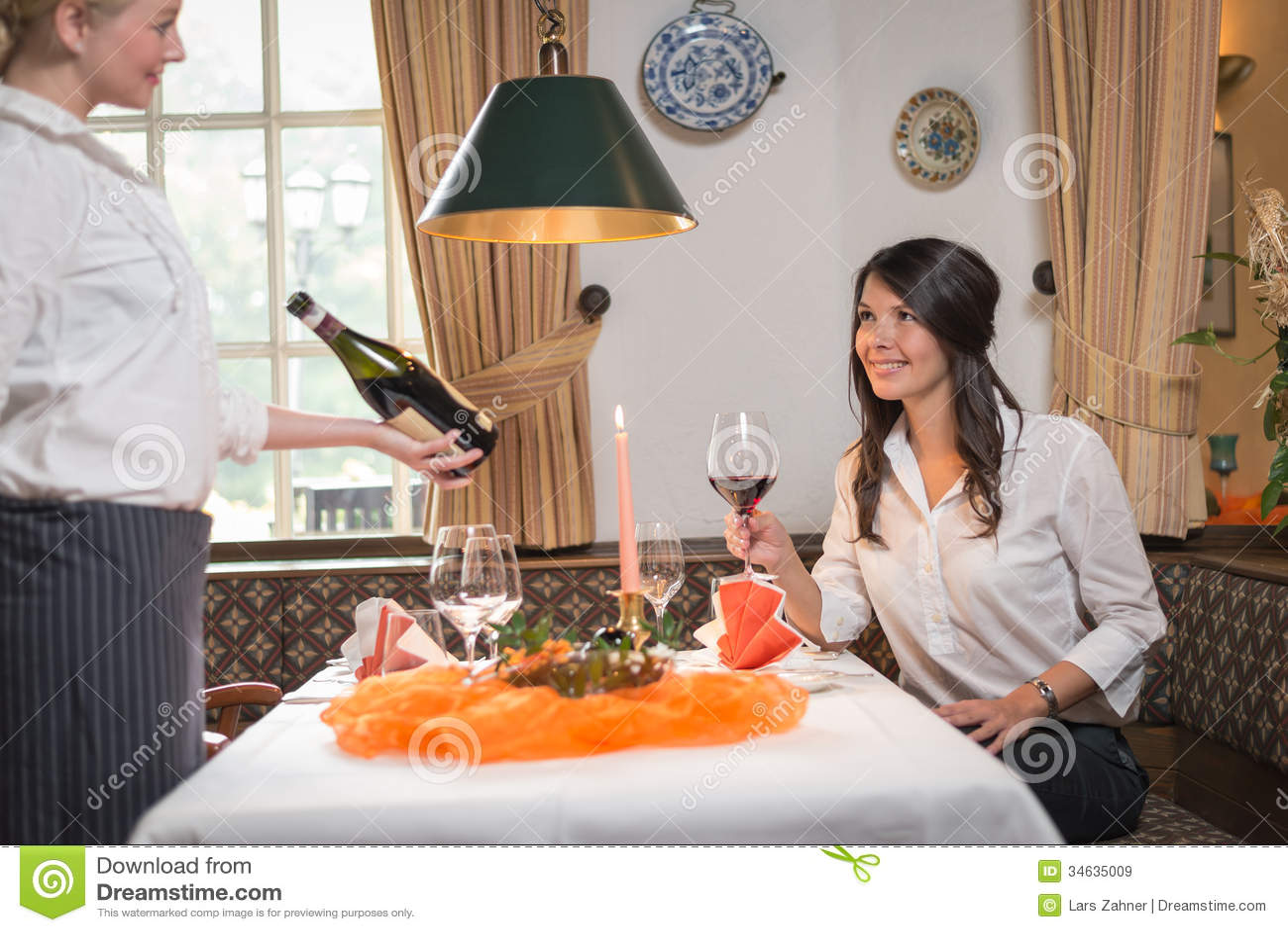 Waiter Serving Wine In A Fine Restaurant Royalty Free