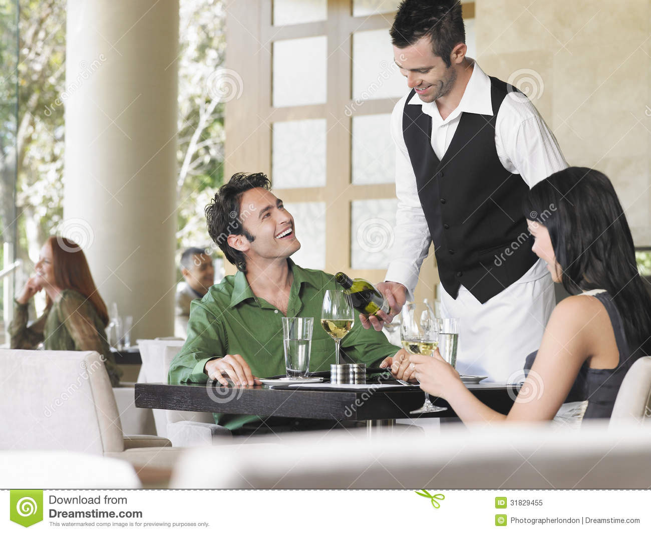Waiter Serving Wine To Couple Royalty Free Stock Photo ...