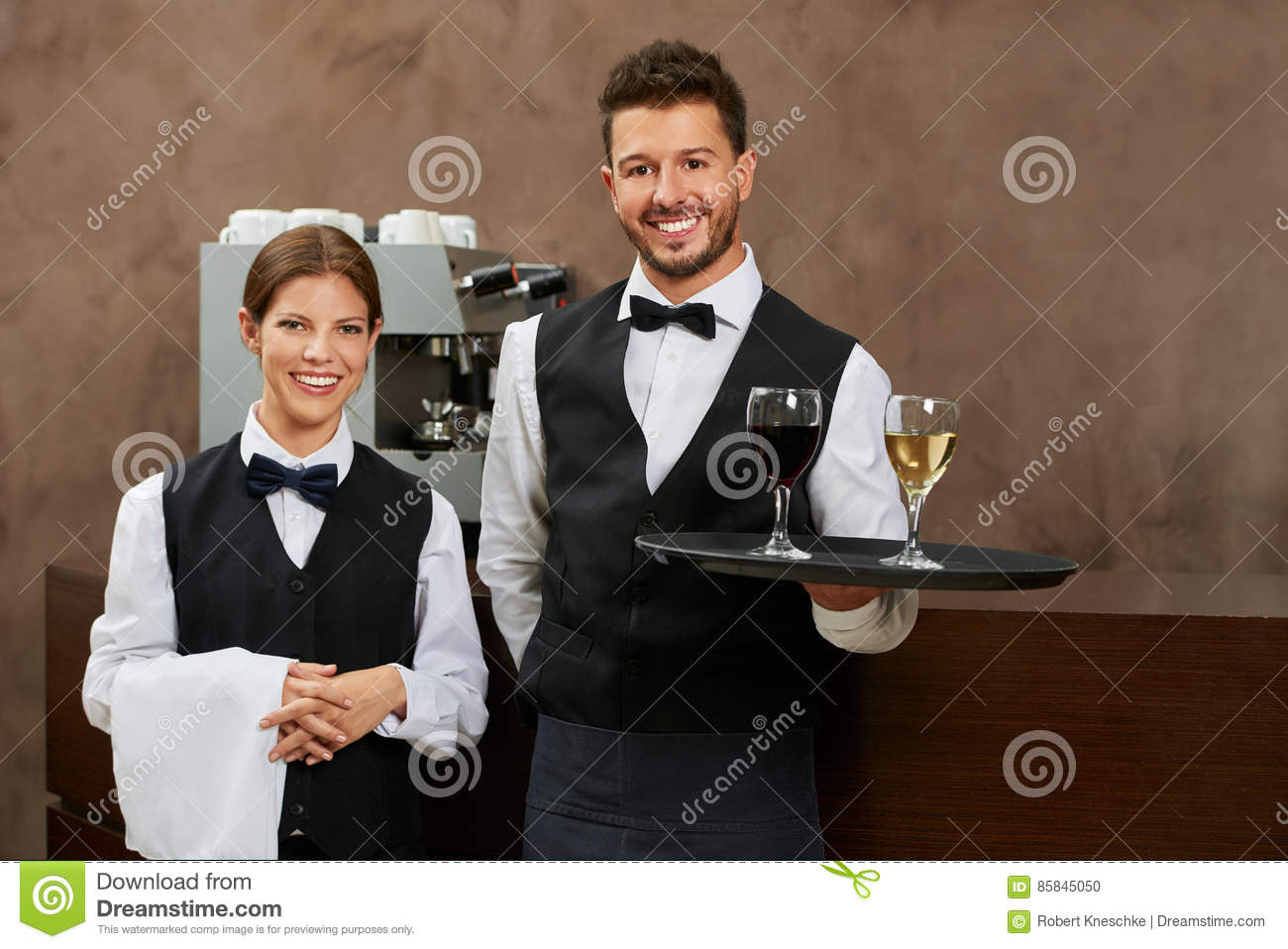 Waiter and waitress serving drinks