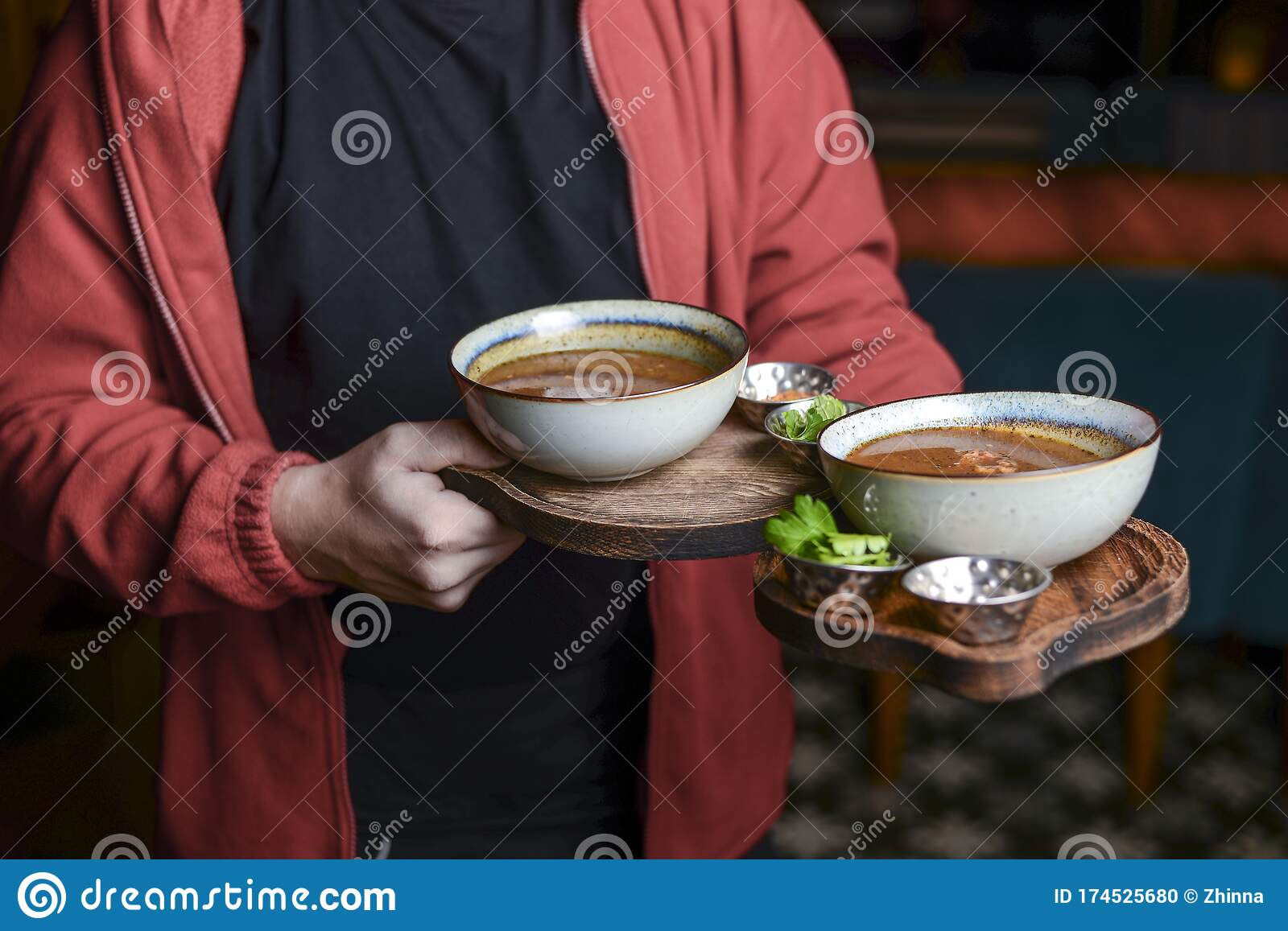 Waiter Wearing Unifrom Serving Two Bowls Of Hot Soup And Fresh Bread Restaurant Photography Concept Stock Photo Image Of Caucasian Mature 174525680