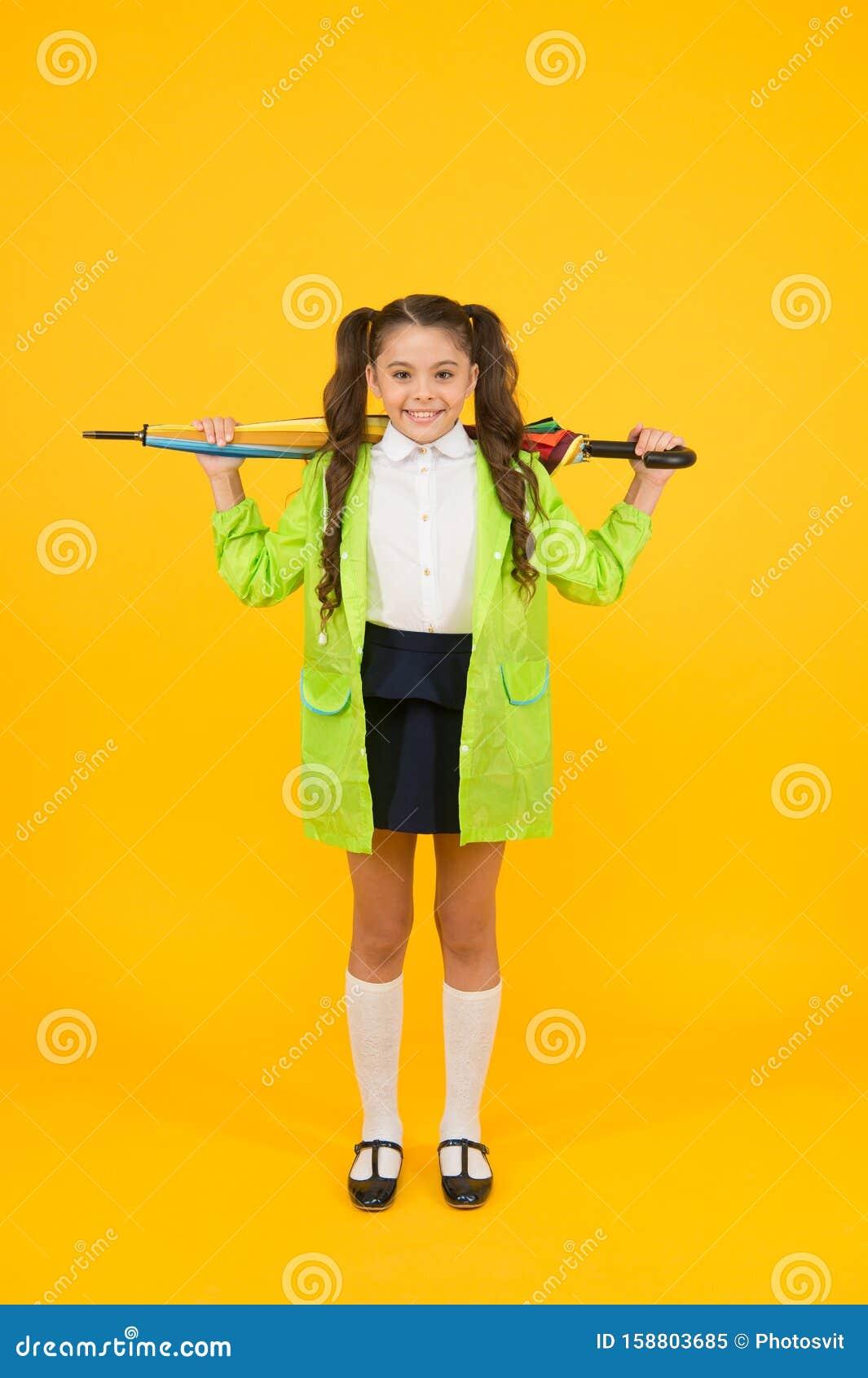 Waiting For Rainy Days. Schoolgirl Stylish Little Kid With