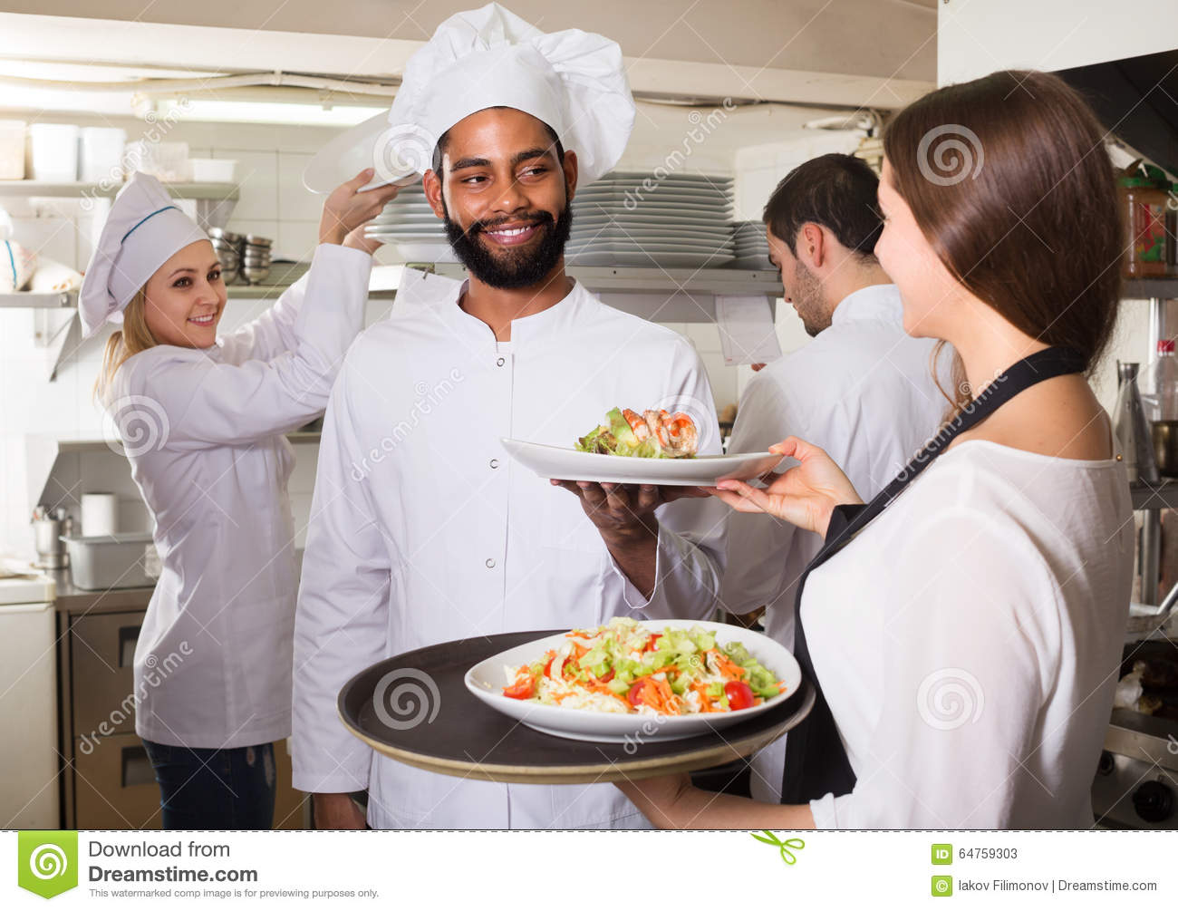 Exterior: Waitress And Cooking Team In Restaurant Stock Image