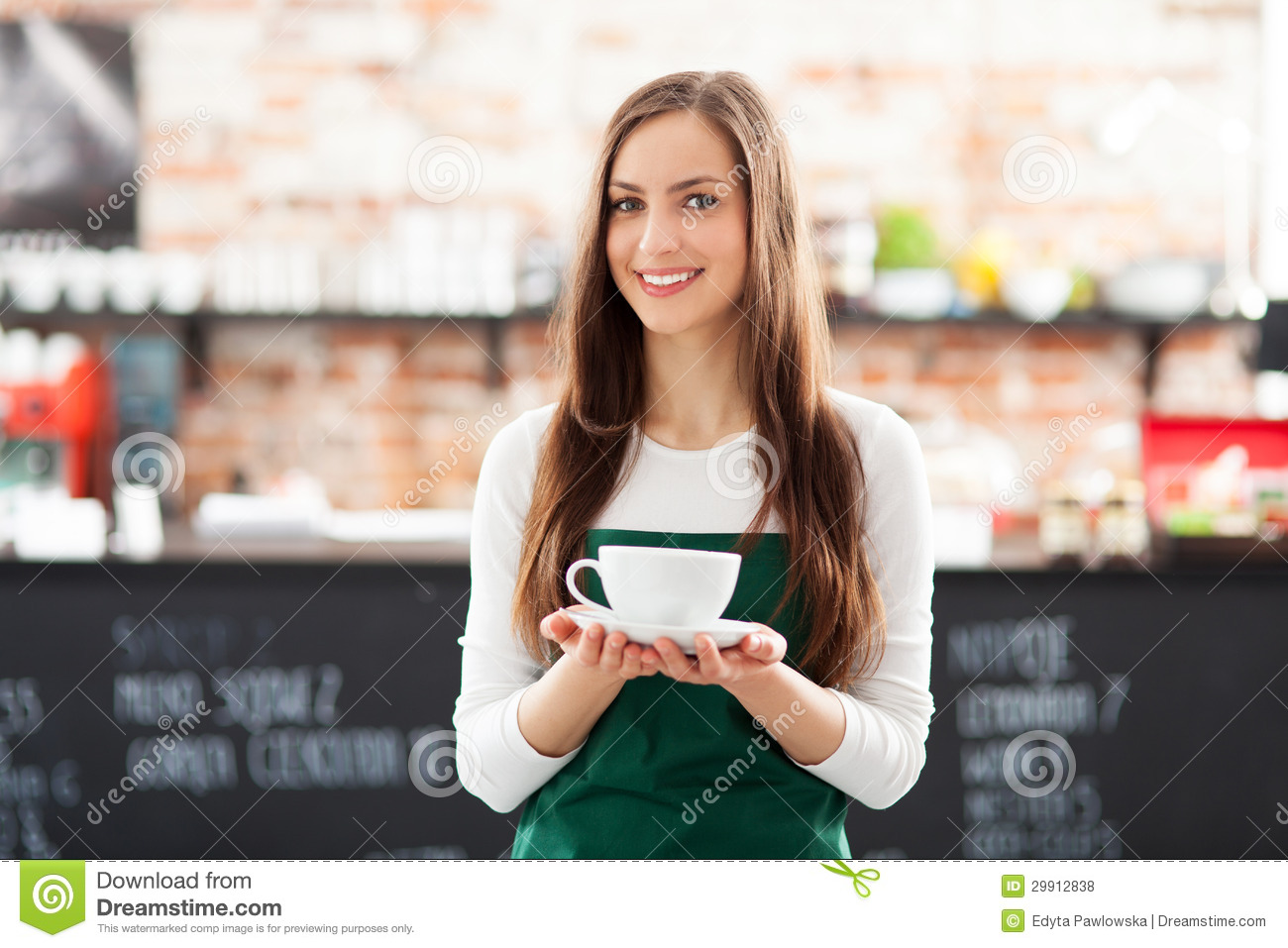 Waitress Holding Cup Of Coffee Royalty Free Stock Photos