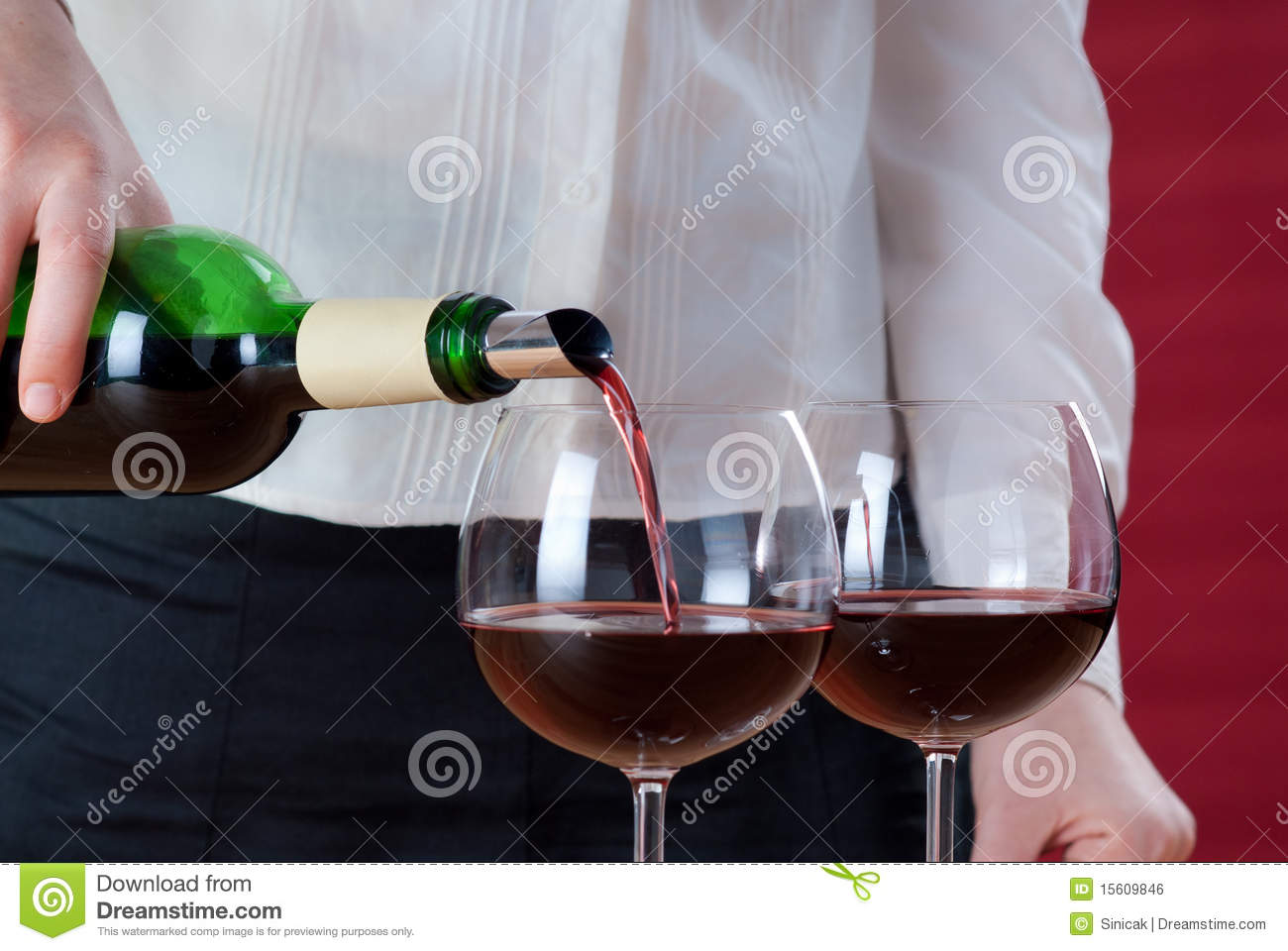 Waitress pouring red wine
