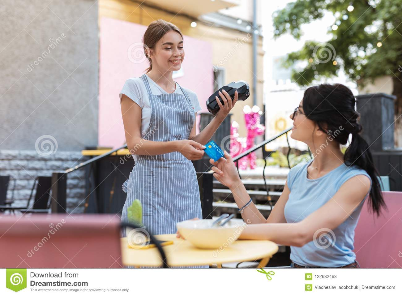Waitress Wearing Striped Apron Receiving Bank Card From Client Stock