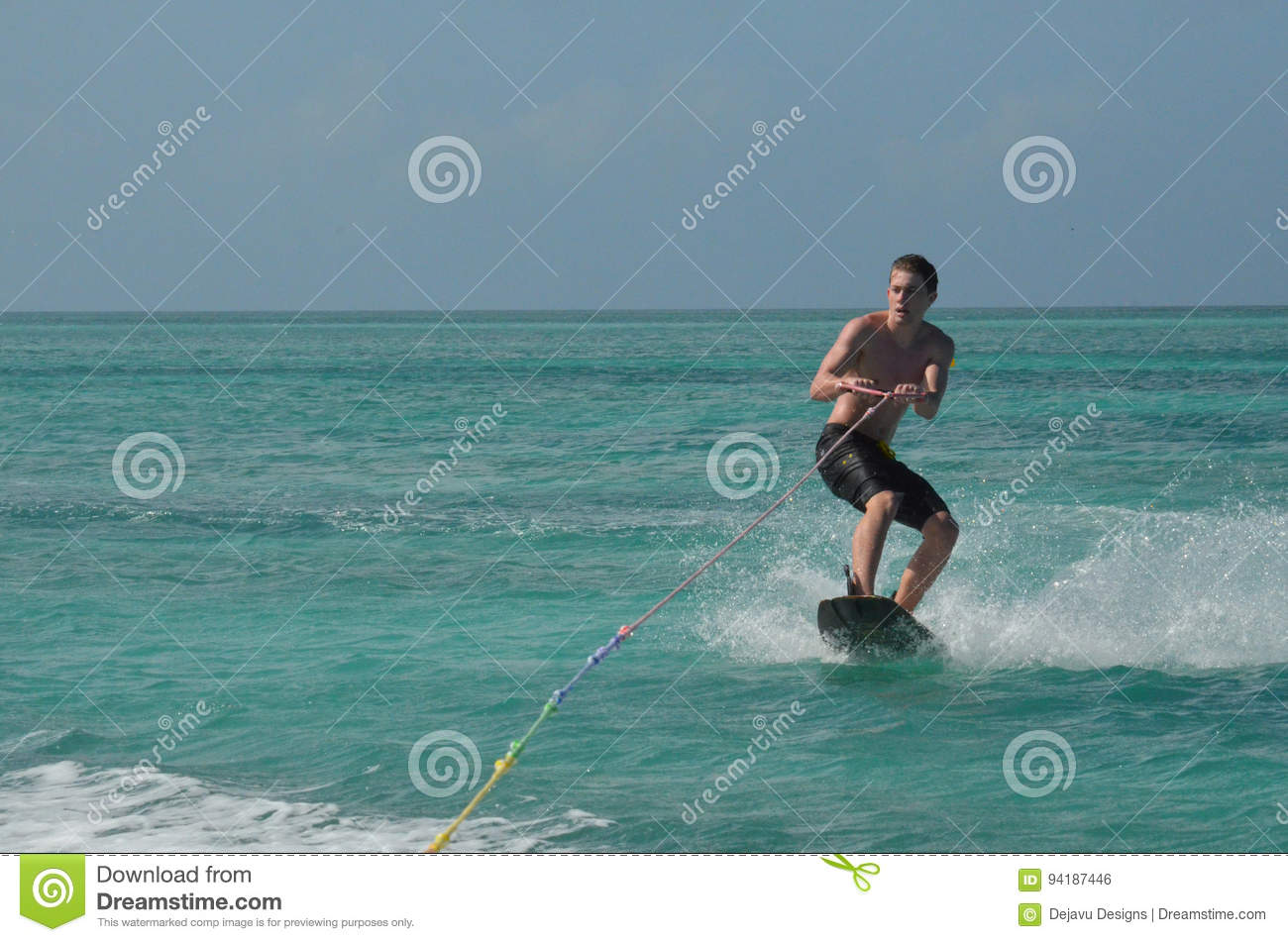 Boat Tow Rope Airhead Harness Stock Photo Wakeboarder Being Pulled Young Man Wakeboarding Behind Aruba Image 1300x951
