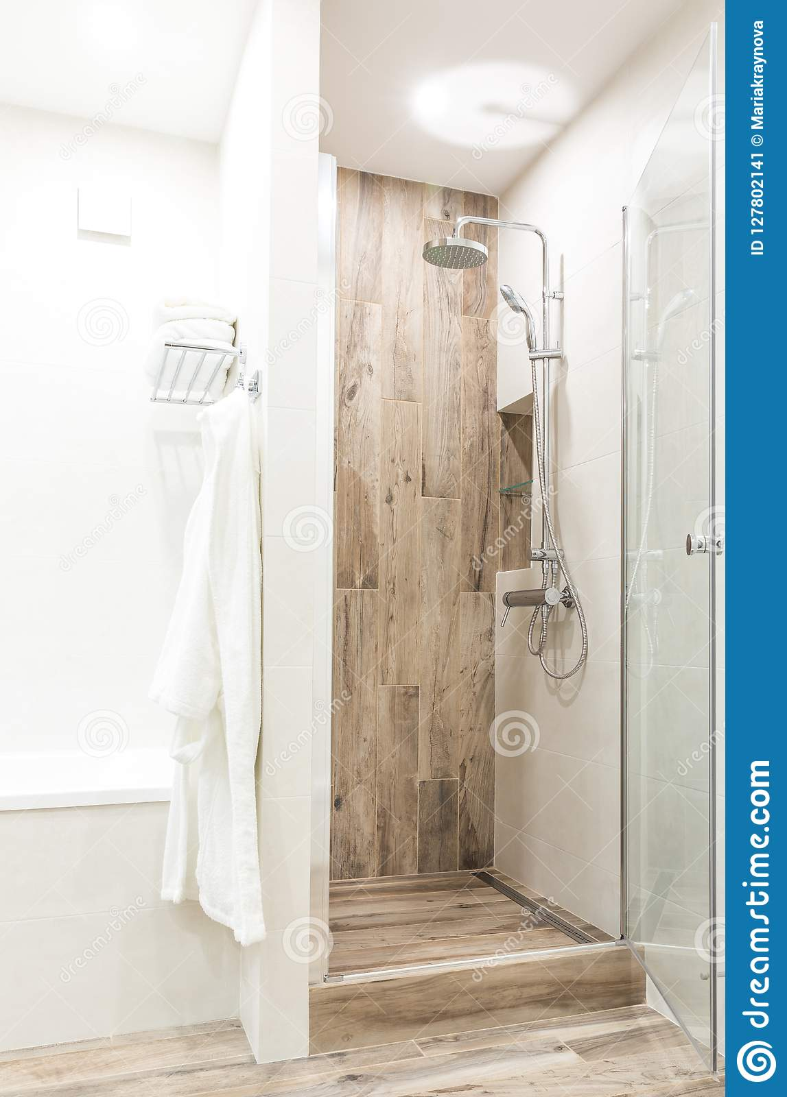 Walk In Shower In Bathroom With Wooden Style Tile Stock