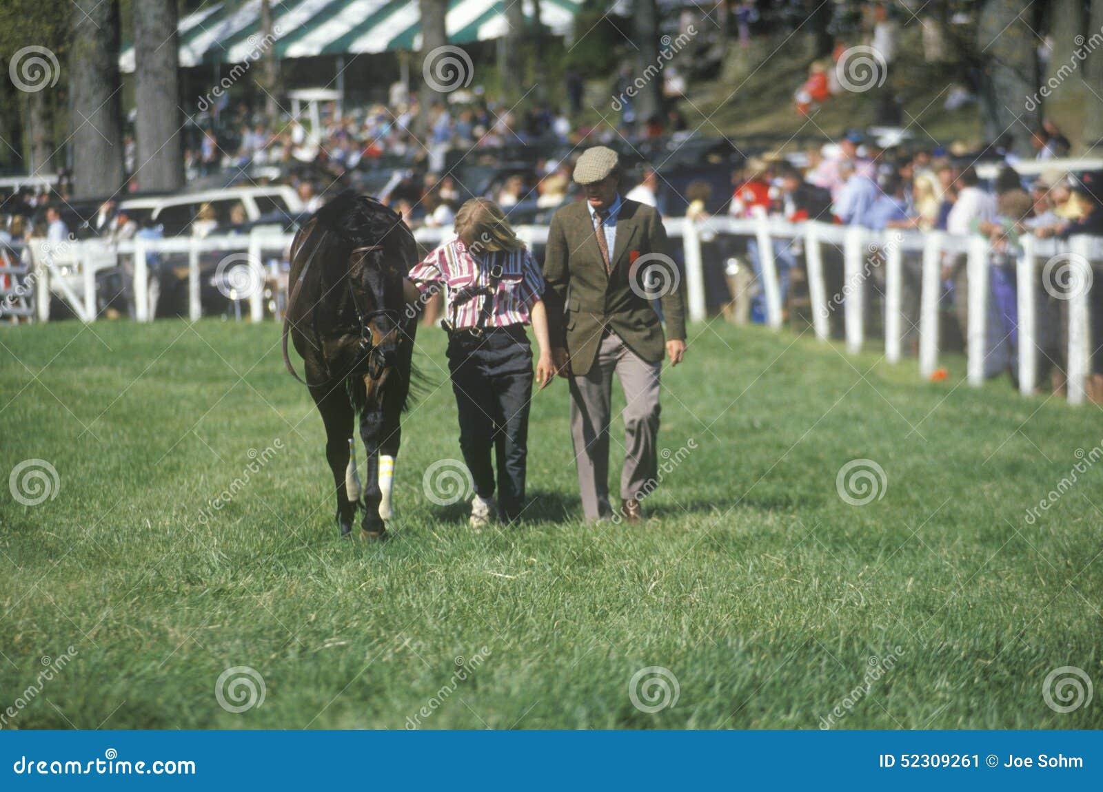 Walker with horse during Spring Steeplechase race, Glenwood Park, Middleburg, Virginia