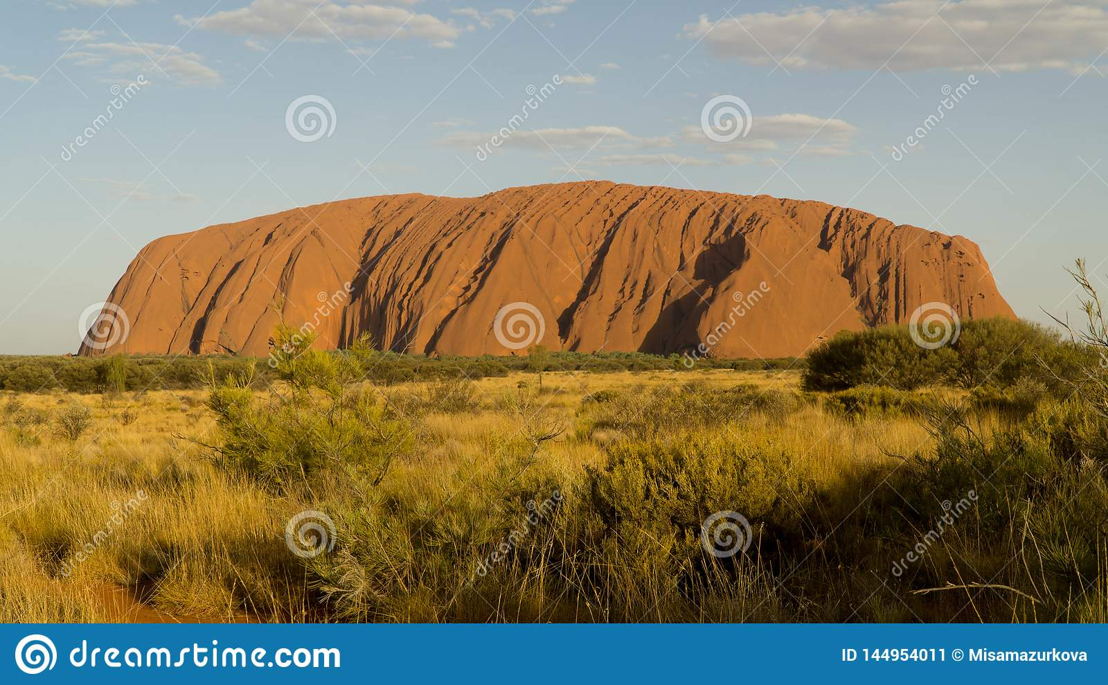 Walking around mystical Ayers Rock Uluru situated in Red Centre of Australia
