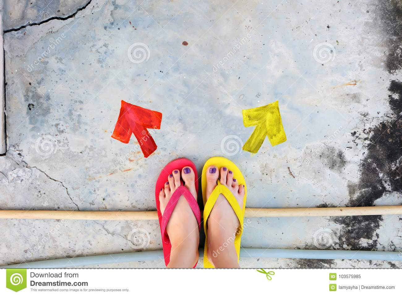 Walking Arrows Directions Drawn. Woman Wear Flip Flop Red and Yellow Standing on Cement Background