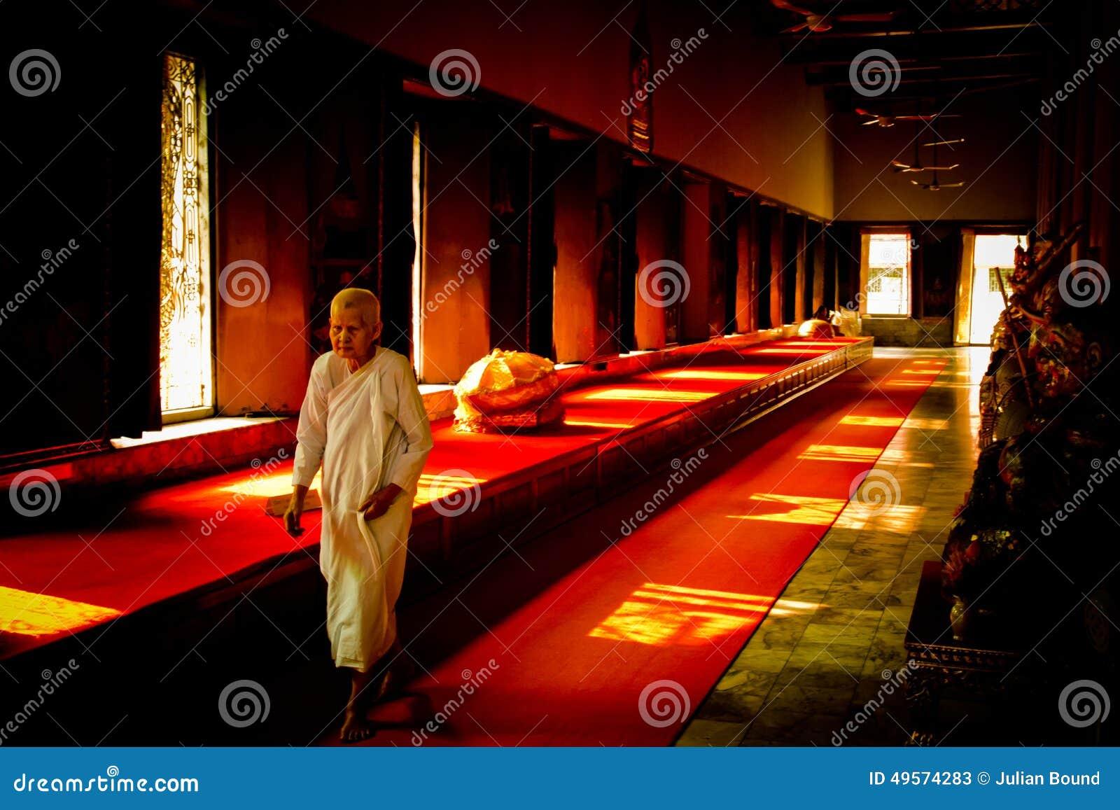 A walking Buddhist nun in a temple in Bangkok, Thailand