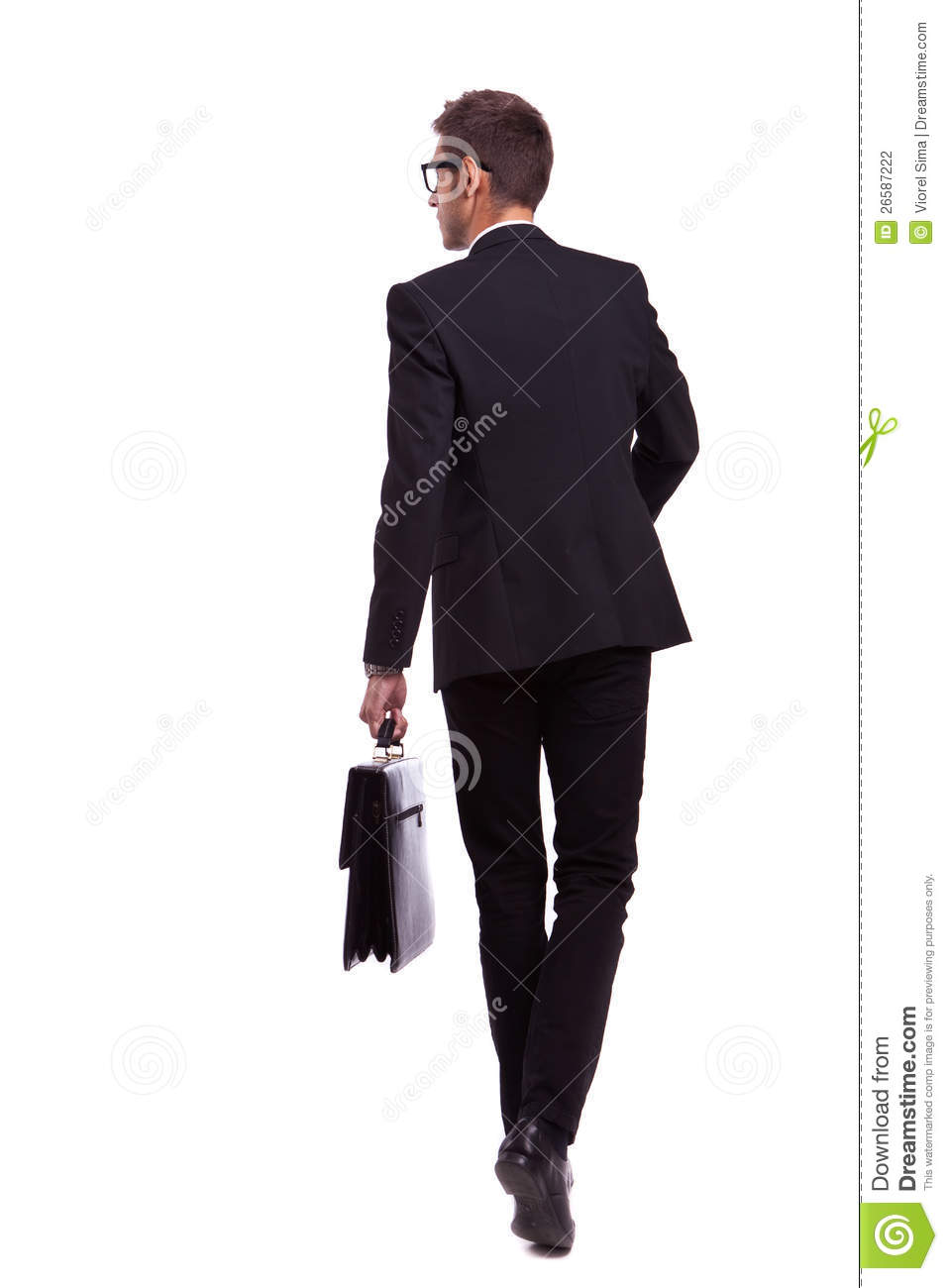 walking business man holding a briefcase stock photo