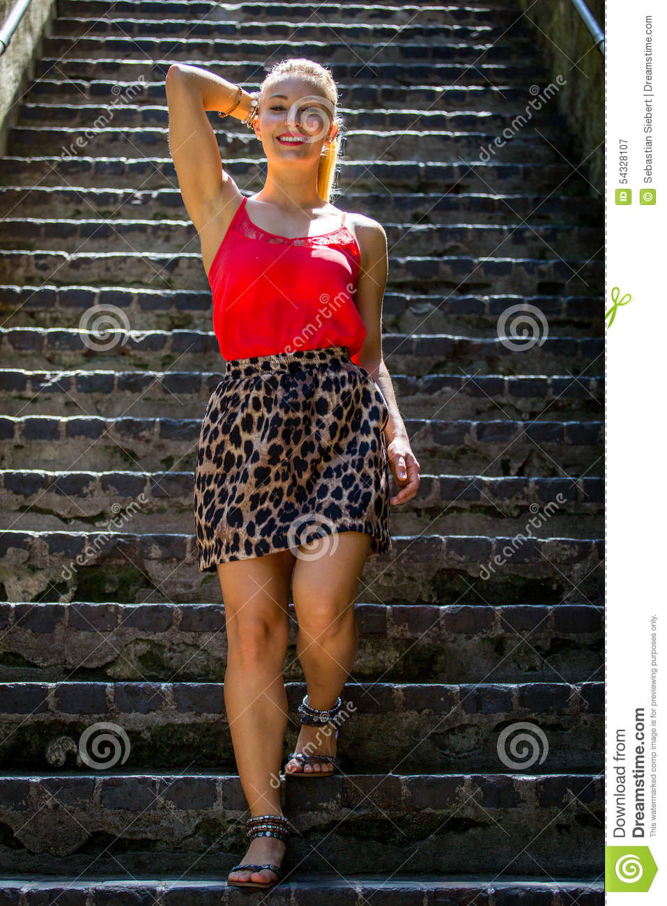 Woman Walking Down The Stairs · Free Stock Photo