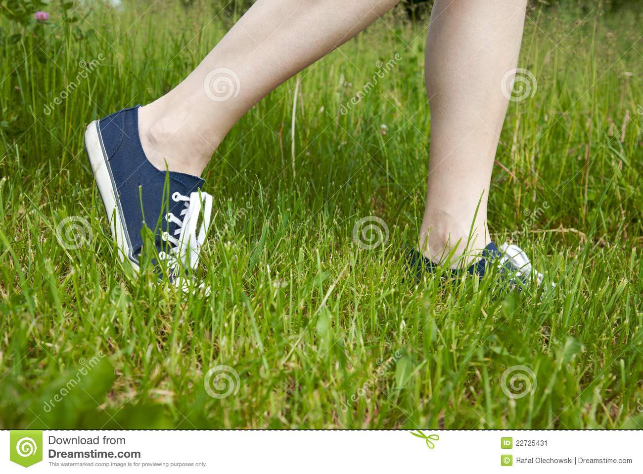 Walking On Green Grass In Sport Shoes Stock Image - Image ...