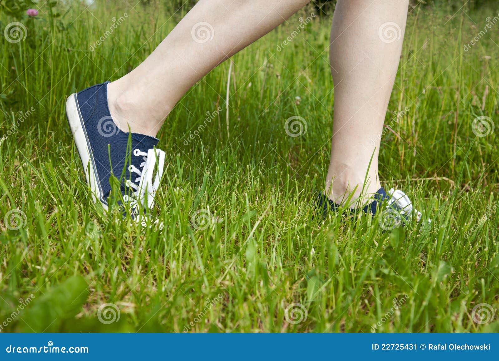 woman walking in grass - photo #17
